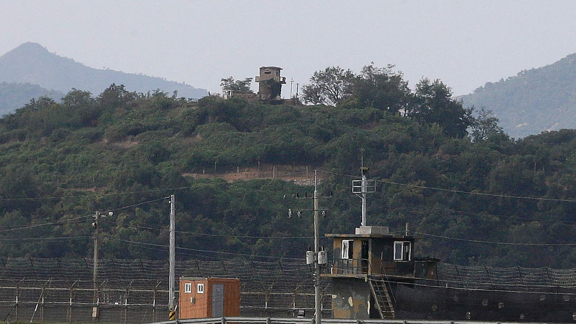 Sept. 29, 2016: Military guard posts of North Korea, rear, and South Korea, bottom, are seen in Paju, at the border with North Korea, South Korea.