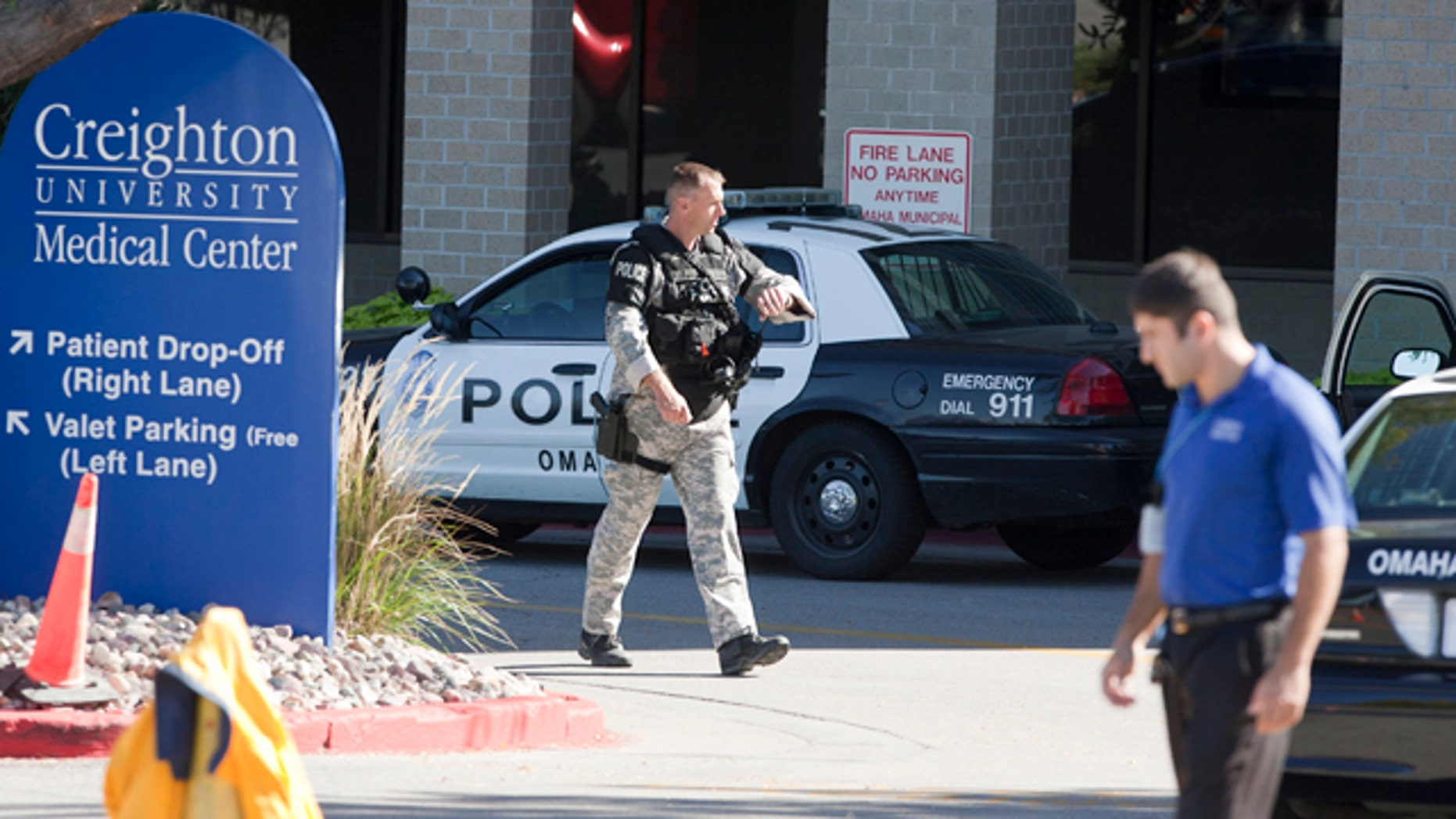 Sept. 29: A police SWAT team member walks out of the Creighton University medical center in Omaha, Neb.