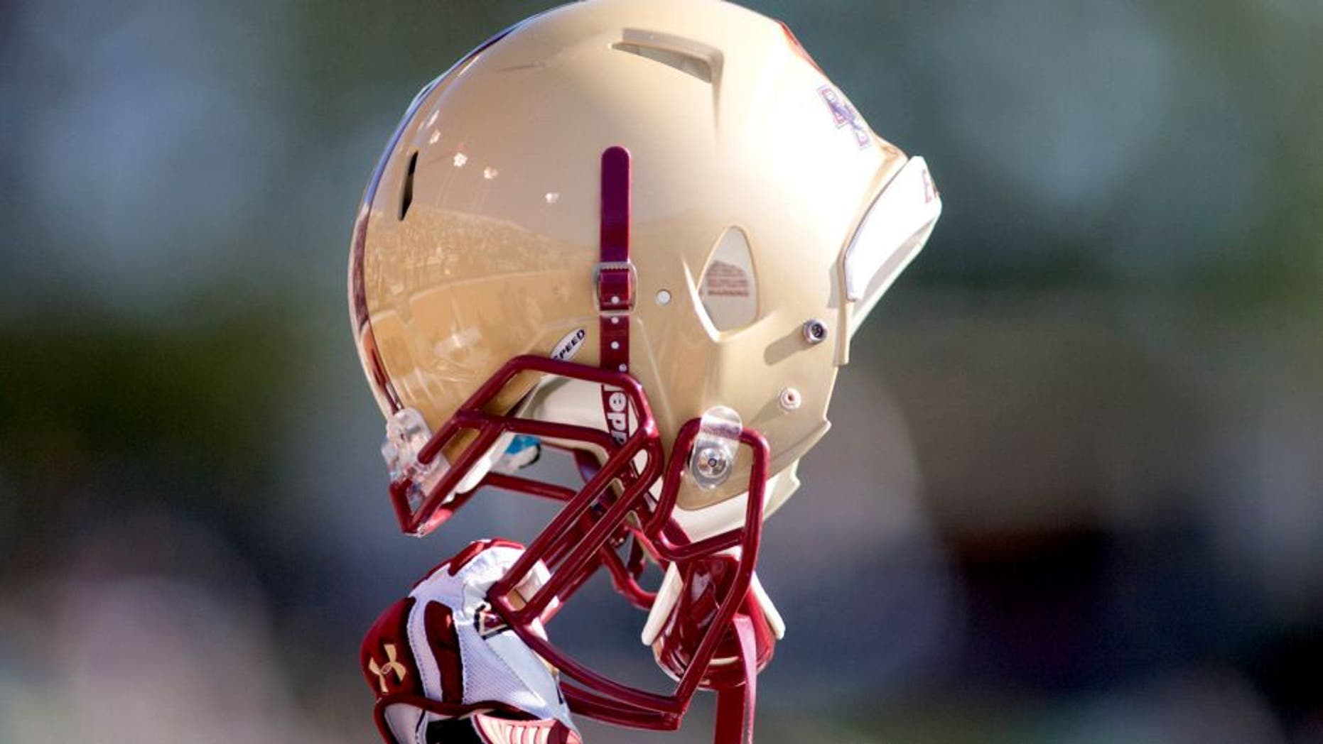 Nov 3, 2012; Winston Salem, NC, USA; A Boston College Eagles player raises his helmet during kickoff in the first quarter against the Wake Forest Demon Deacons at BB&T field. Mandatory Credit: Jeremy Brevard-USA TODAY Sports