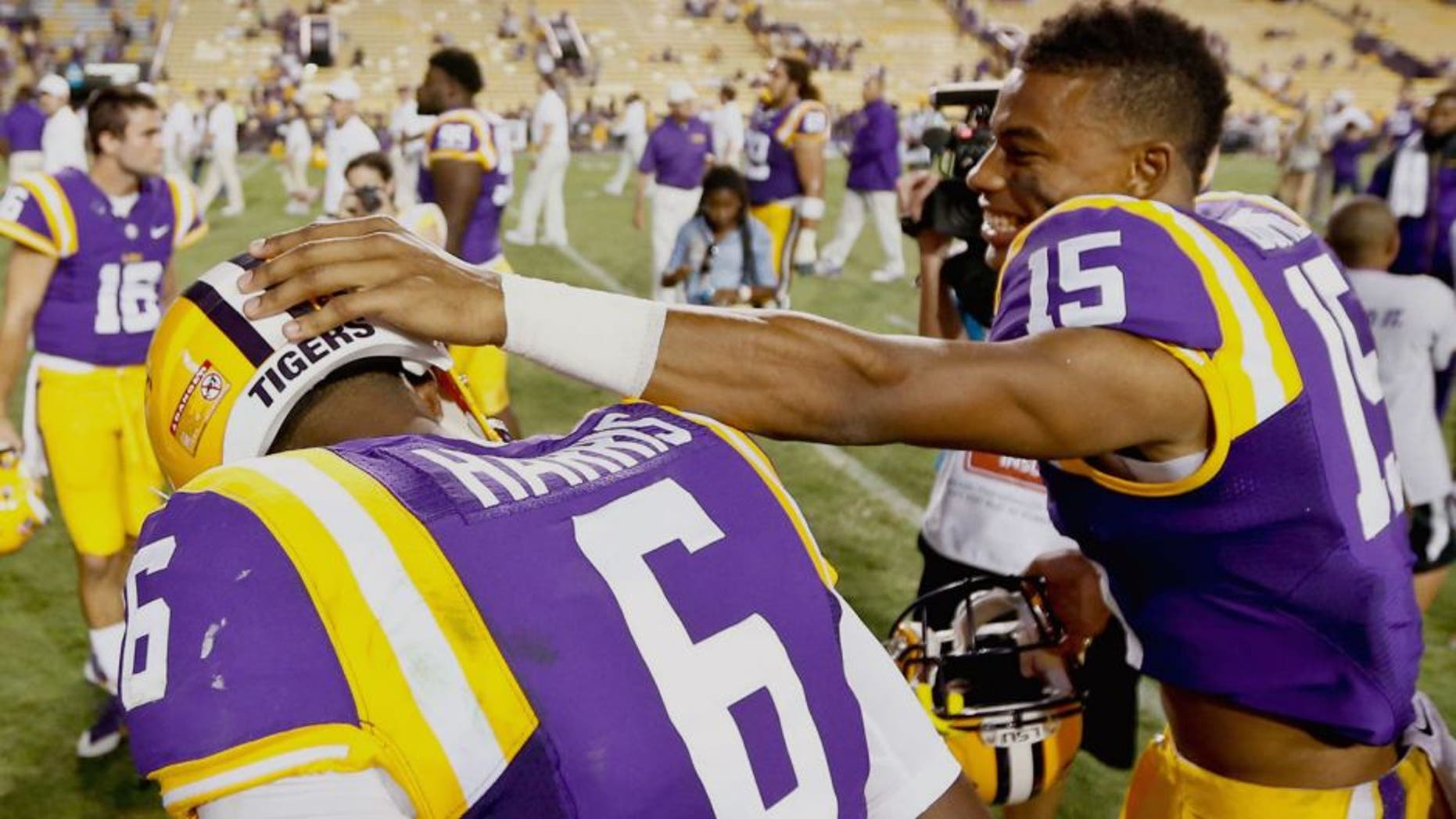 Sep 27, 2014; Baton Rouge, LA, USA; LSU Tigers wide receiver Malachi Dupre (15) and quarterback Brandon Harris (6) celebrate following a win against the New Mexico State Aggies in a game at Tiger Stadium. LSU defeated New Mexico State 63-7. Mandatory Credit: Derick E. Hingle-USA TODAY Sports