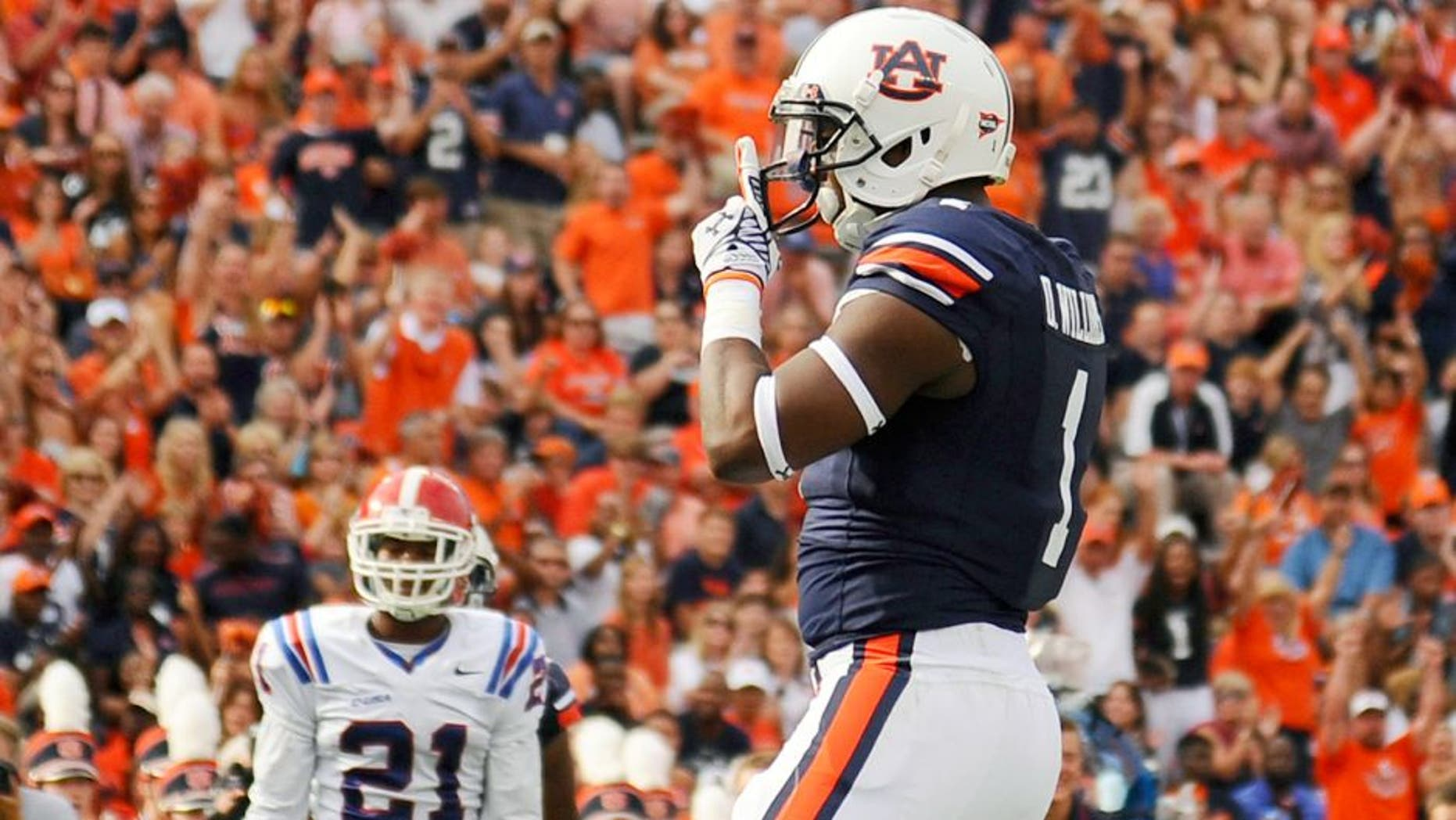 Sep 27, 2014; Auburn, AL, USA; Auburn Tigers wide receiver D'haquille Williams (1) celebrates a touchdown during the first half against the Louisiana Tech Bulldogs at Jordan Hare Stadium. Mandatory Credit: Shanna Lockwood-USA TODAY Sports