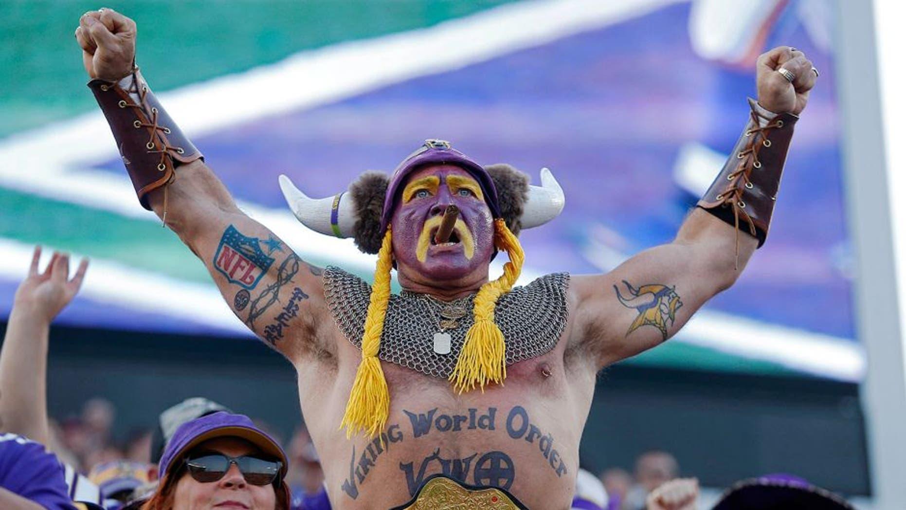 Sep 28, 2014; Minneapolis, MN, USA; Minnesota Vikings fan Syd Davy cheers for his team as they play the Atlanta Falcons at TCF Bank Stadium. The Vikings win 41-28. Mandatory Credit: Bruce Kluckhohn-USA TODAY Sports