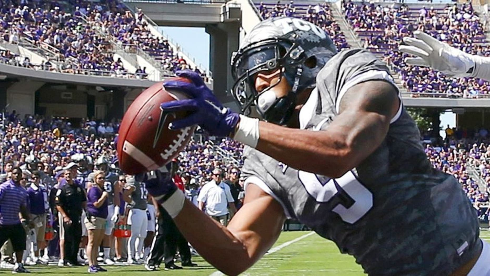 FORT WORTH, TX - SEPTEMBER 12: Josh Doctson #9 of the TCU Horned Frogs fails to hang onto a touch down pass under coverage from Demundre Freeman #26 of the Stephen F. Austin Lumberjacks in the first half at Amon G. Carter Stadium on September 12, 2015 in Fort Worth, Texas. (Photo by Tom Pennington/Getty Images)