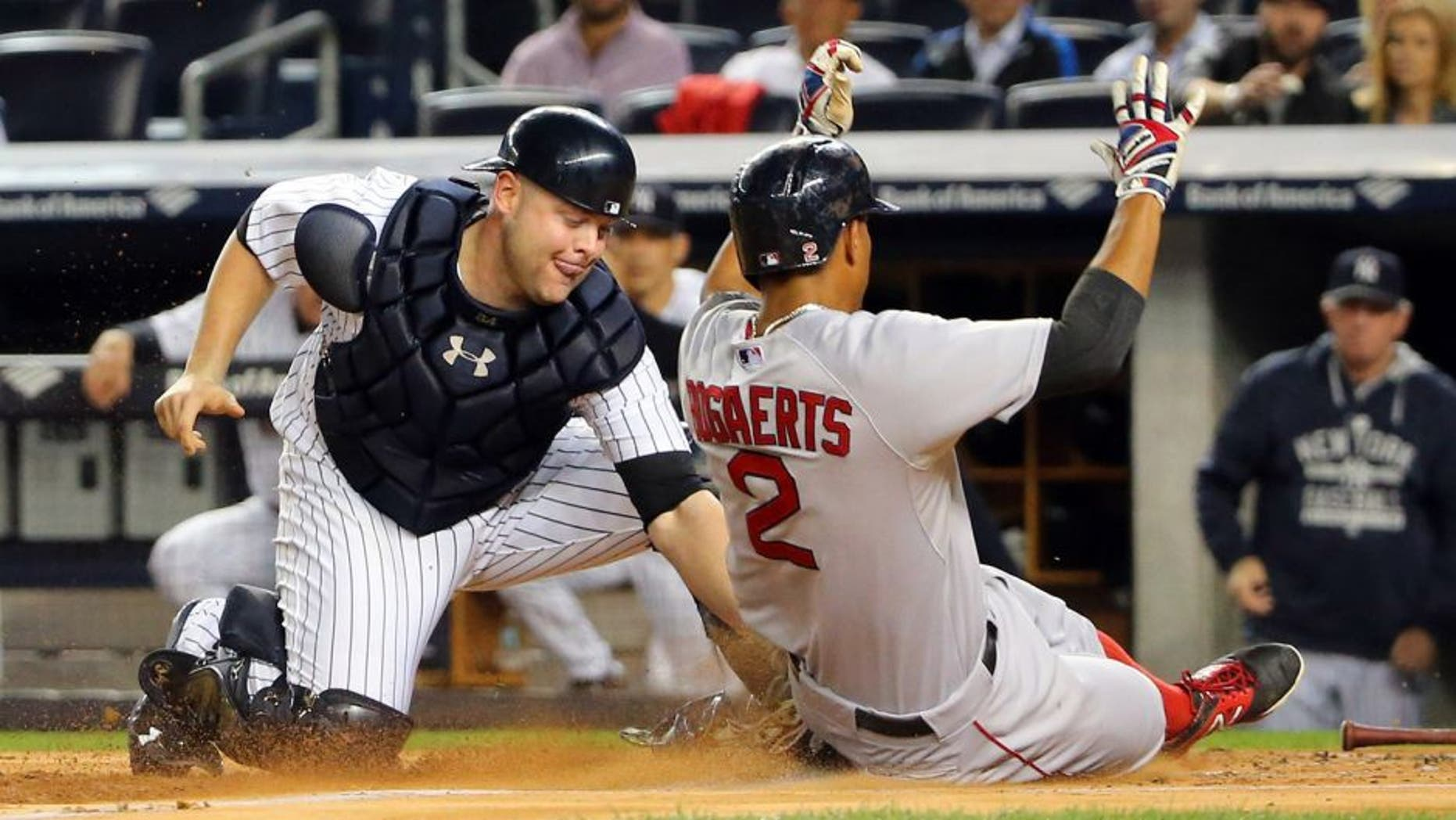 Sep 29, 2015; Bronx, NY, USA; Boston Red Sox shortstop Xander Bogaerts (2) slides safe as New York Yankees catcher Brian McCann (34) is late with the tag during the first inning at Yankee Stadium. Mandatory Credit: Anthony Gruppuso-USA TODAY Sports