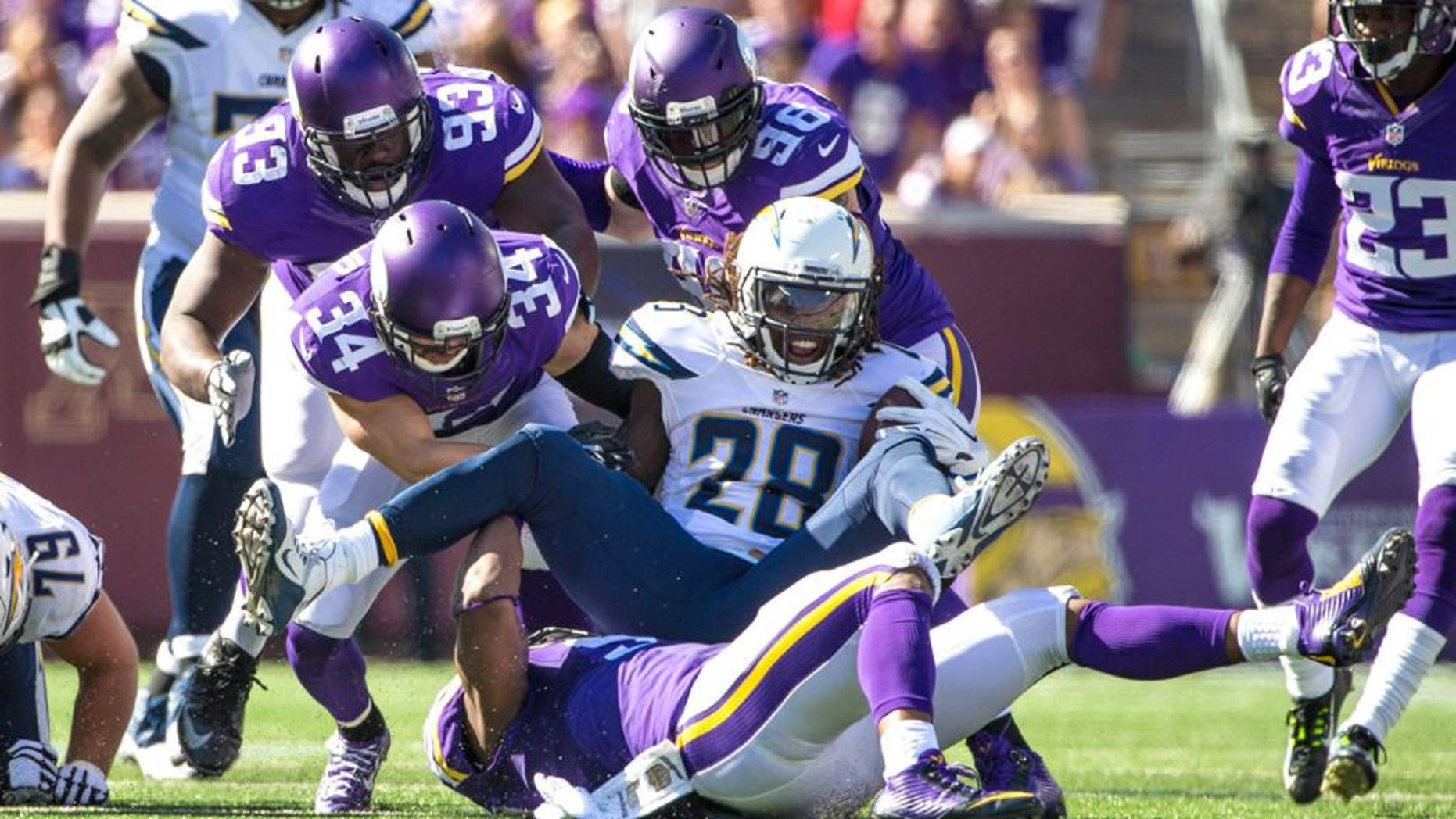 Sep 27, 2015; Minneapolis, MN, USA; San Diego Chargers running back Melvin Gordon (28) is tackled by Minnesota Vikings safety Andrew Sendejo (34) during the third quarter at TCF Bank Stadium. The Vikings defeated the Chargers 31-14. Mandatory Credit: Brace Hemmelgarn-USA TODAY Sports