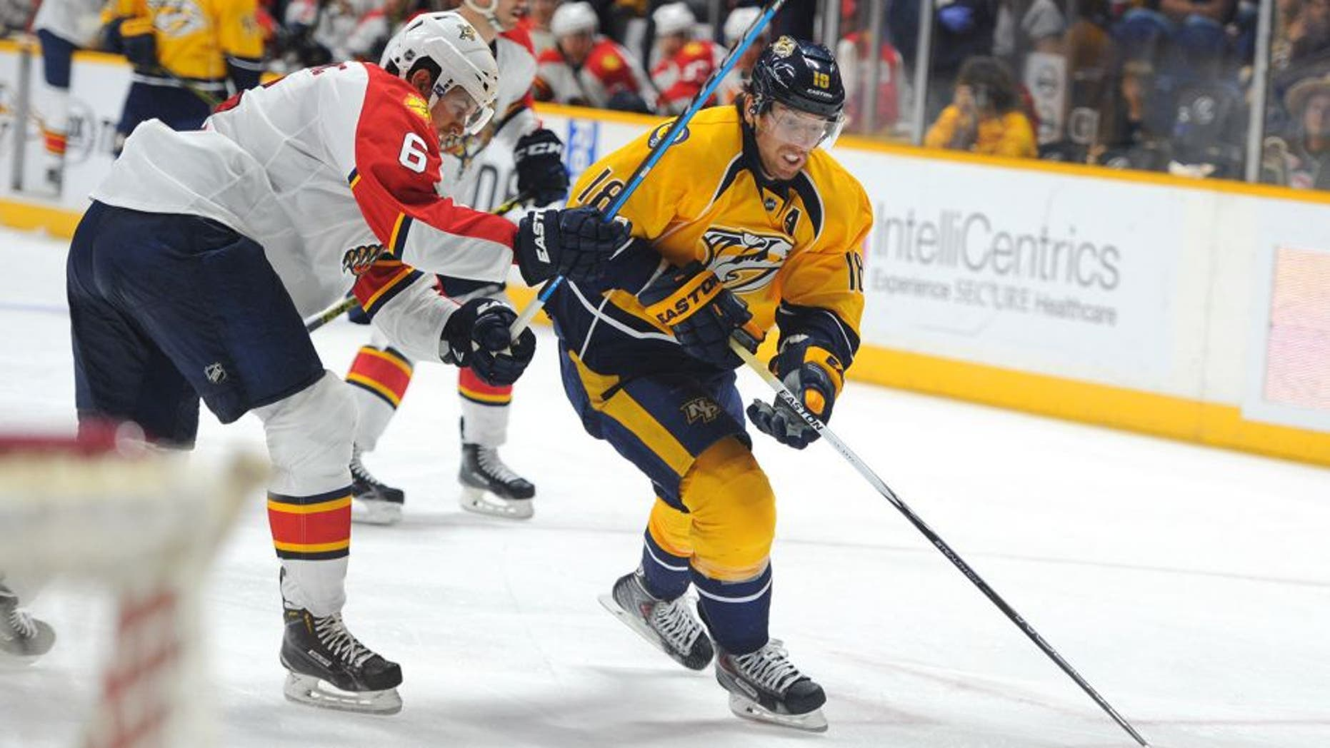 Sep 20, 2015; Nashville, TN, USA; Nashville Predators left winger James Neal (18) skates the puck into the zone during the third period against the Florida Panthers at Bridgestone Arena. Mandatory Credit: Christopher Hanewinckel-USA TODAY Sports