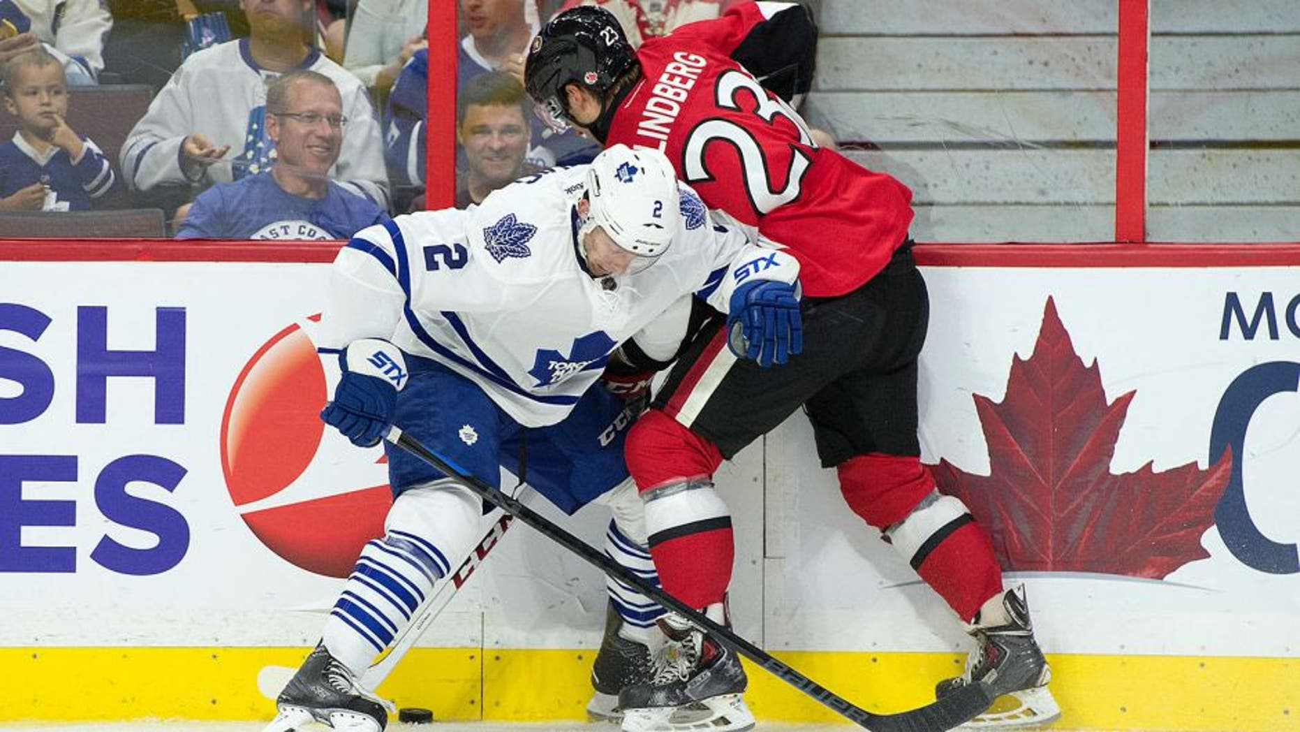 Sep 21, 2015; Ottawa, Ontario, CAN; Toronto Maple Leafs defenseman Matt Hunwick (2) and Ottawa Senators ight wing Tobias Lindberg (23) battle for the puck in the second period at Canadian Tire Centre. Mandatory Credit: Marc DesRosiers-USA TODAY Sports
