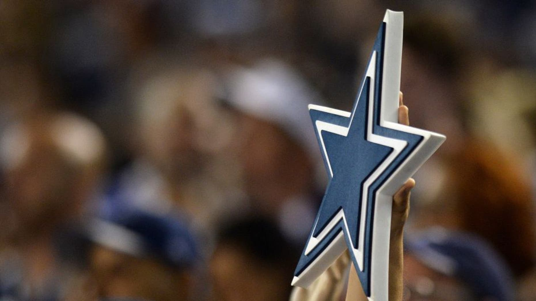 Aug 13, 2015; San Diego, CA, USA; A Dallas Cowboys fan hold up their logo during the third quarter against the San Diego Chargers in a preseason NFL football game at Qualcomm Stadium. Mandatory Credit: Jake Roth-USA TODAY Sports