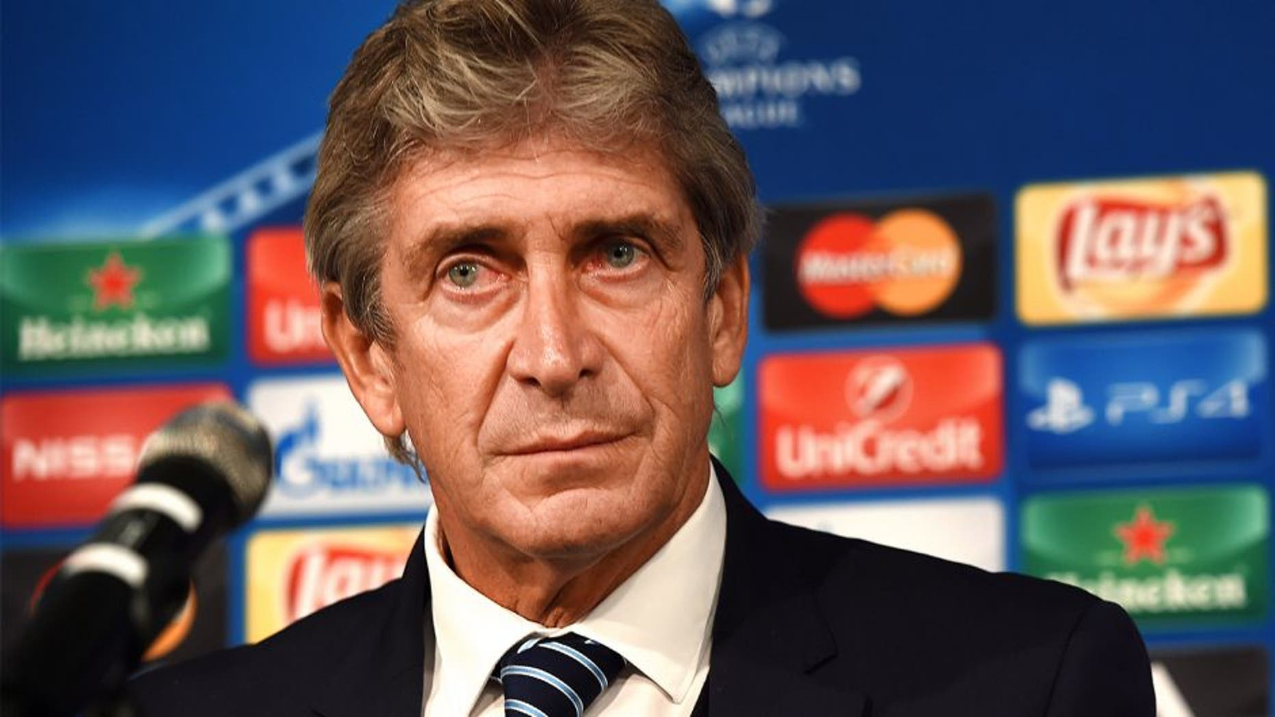 Manchester´s Chilean head coach Manuel Pellegrini attends a press conference on the eve of the Group D, first-leg UEFA Champions League football match Borussia Moenchengladbach vs Manchester City FC in Moenchengladbach, western Germany on September 29, 2015. AFP PHOTO / PATRIK STOLLARZ (Photo credit should read PATRIK STOLLARZ/AFP/Getty Images)