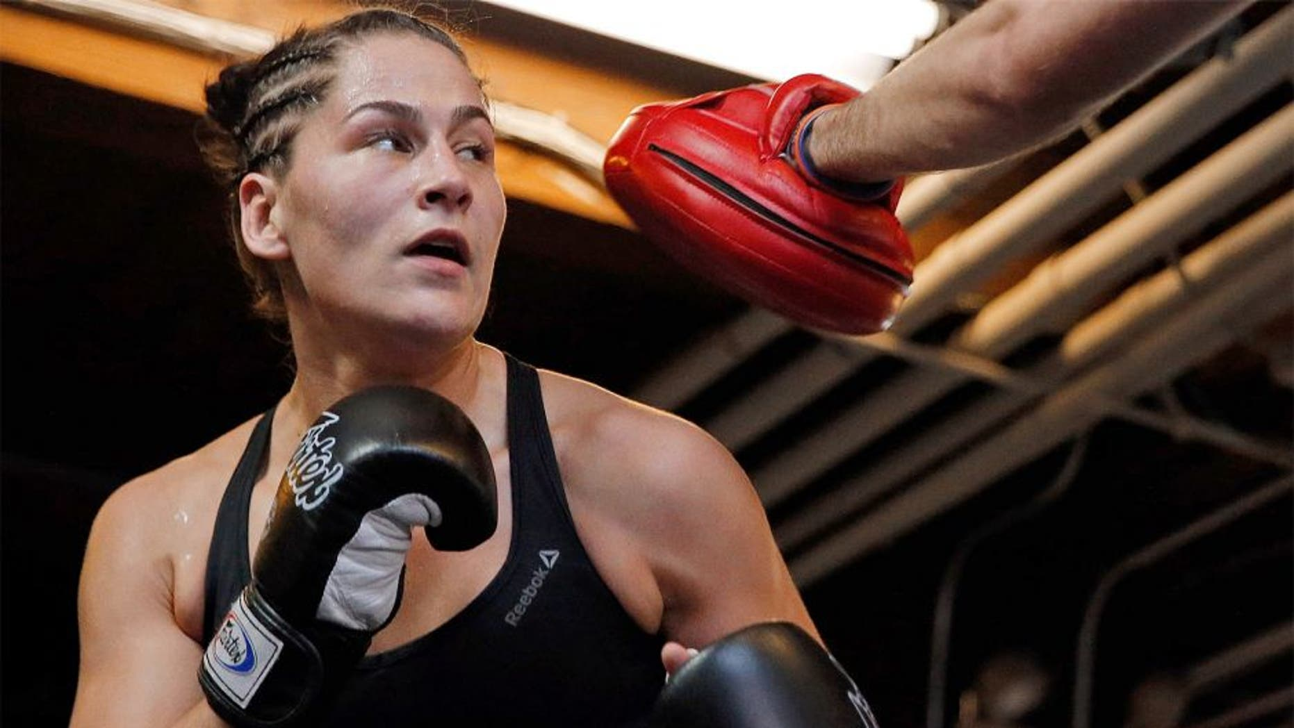 CHICAGO, IL - JULY 23: UFC women's No. 5 bantamweight contender Jessica Eye with boxing coach Alex Cooper during UFC Fight Night: Open Workouts at UFC Gym River North on July 23, 2015 in Chicago, Illinois. (Photo by Jon Durr/Zuffa LLC/Zuffa LLC via Getty Images)