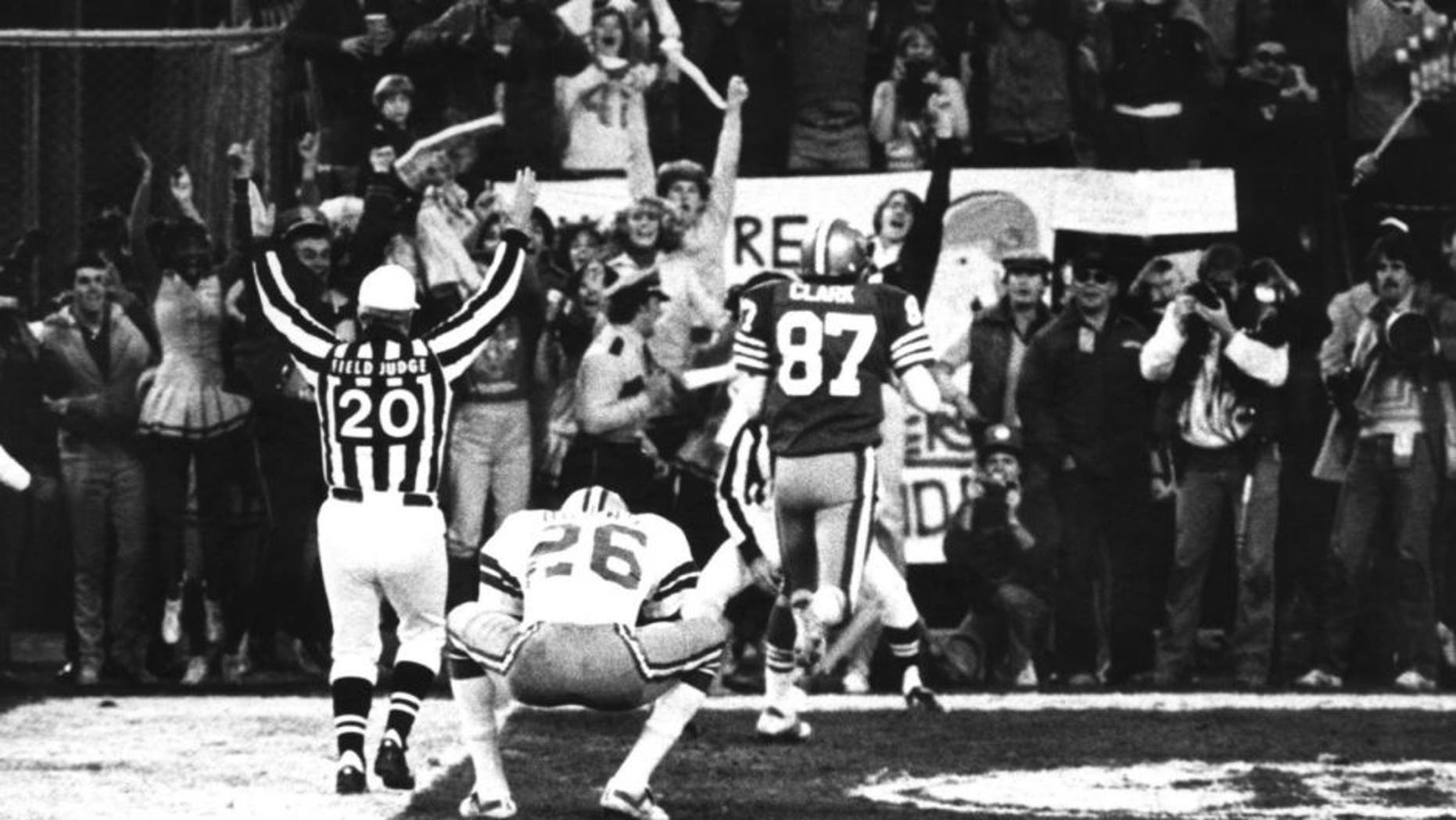 "Wide receiver Dwight Clark of the San Francisco 49ers leaves a Dallas defender in his dust after making ""The Catch"" to defeat the Dallas Cowboys 28-27 in the 1981 NFC Championship Game on January 10, 1982 at Candlestick Park in San Francisco, California. (Photo by Arthur Anderson/Getty Images) *** Local Caption ***"