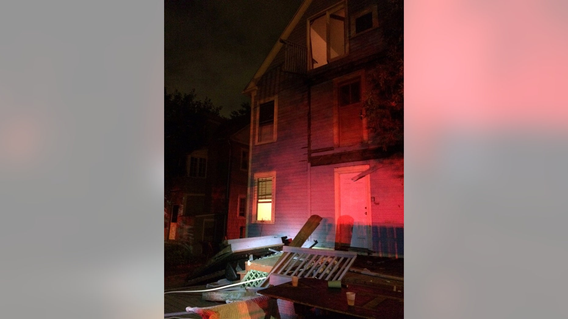 Sept. 10, 2016: This photo provided by the Hartford Police Department shows a collapsed deck at a house near Trinity College in Hartford, Conn.