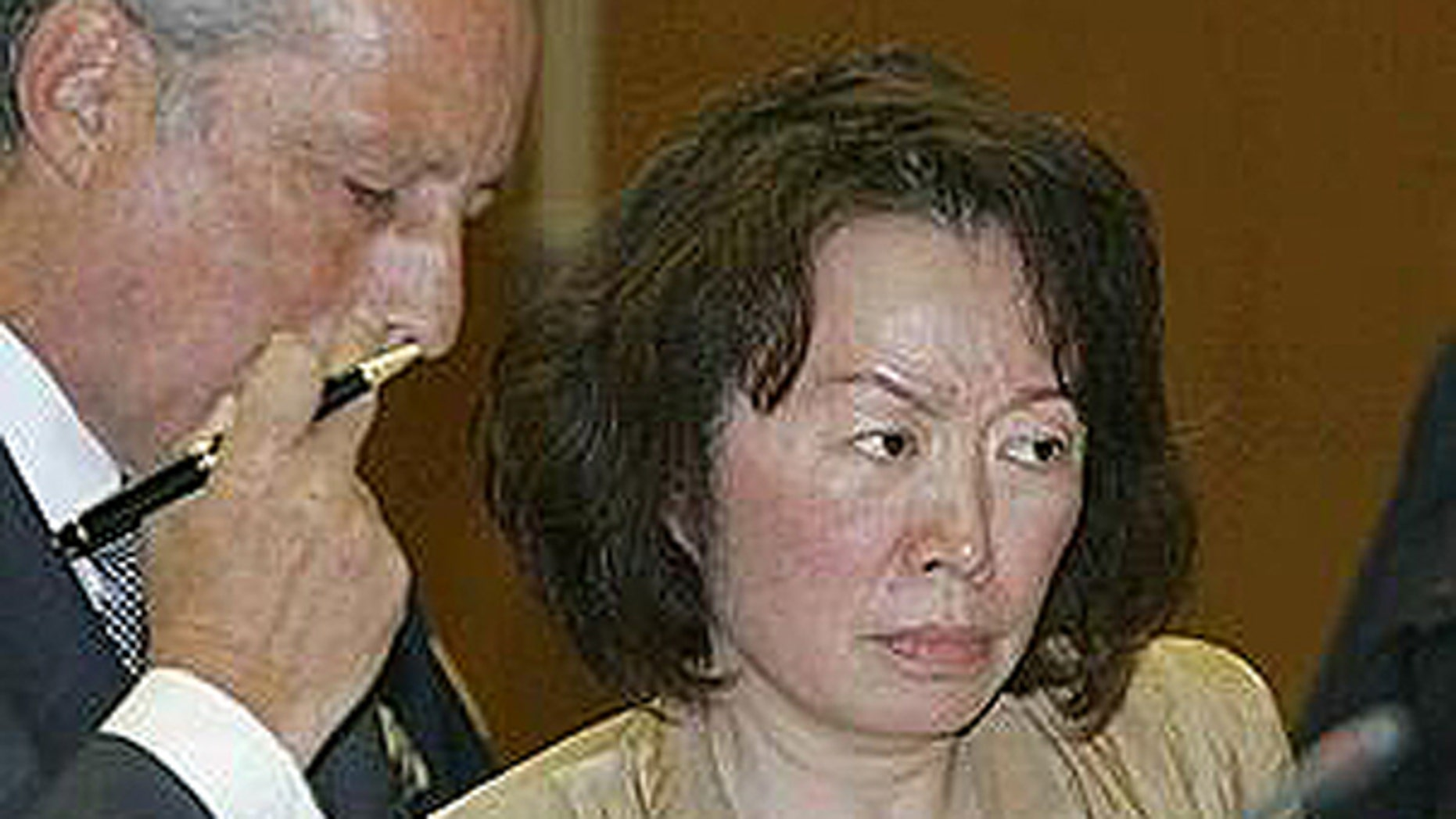 Sept. 16: Former St. John's University Dean Cecilia Chang is pictured here with her lawyer at her arraignment. Chang was arrainged on charges that she charges she embezzled more than $1 million for jaunts to casinos and Victoria's Secret shopping sprees.