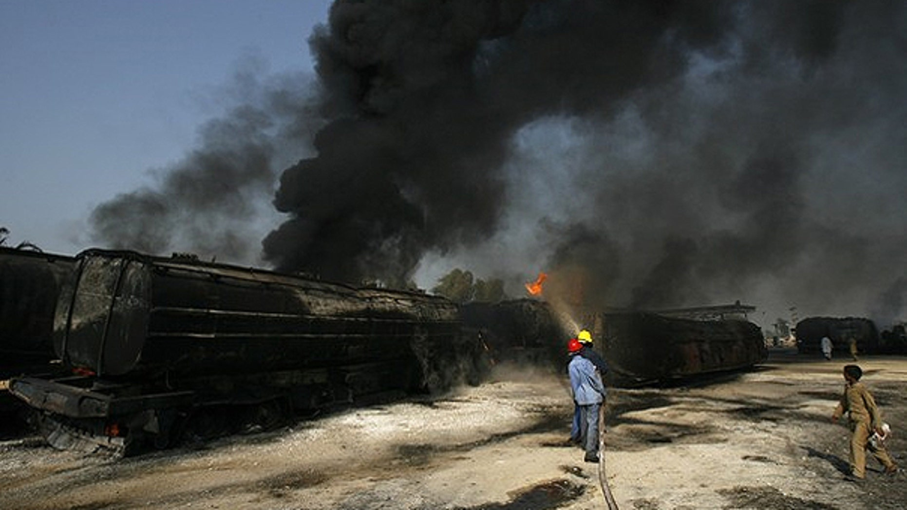 Oct. 1: Firemen extinguish a fire on a burning oil tanker on a highway near Shikarpur, in Pakistan's Sindh province. Suspected militants set fire to tankers carrying fuel for NATO troops in Afghanistan.