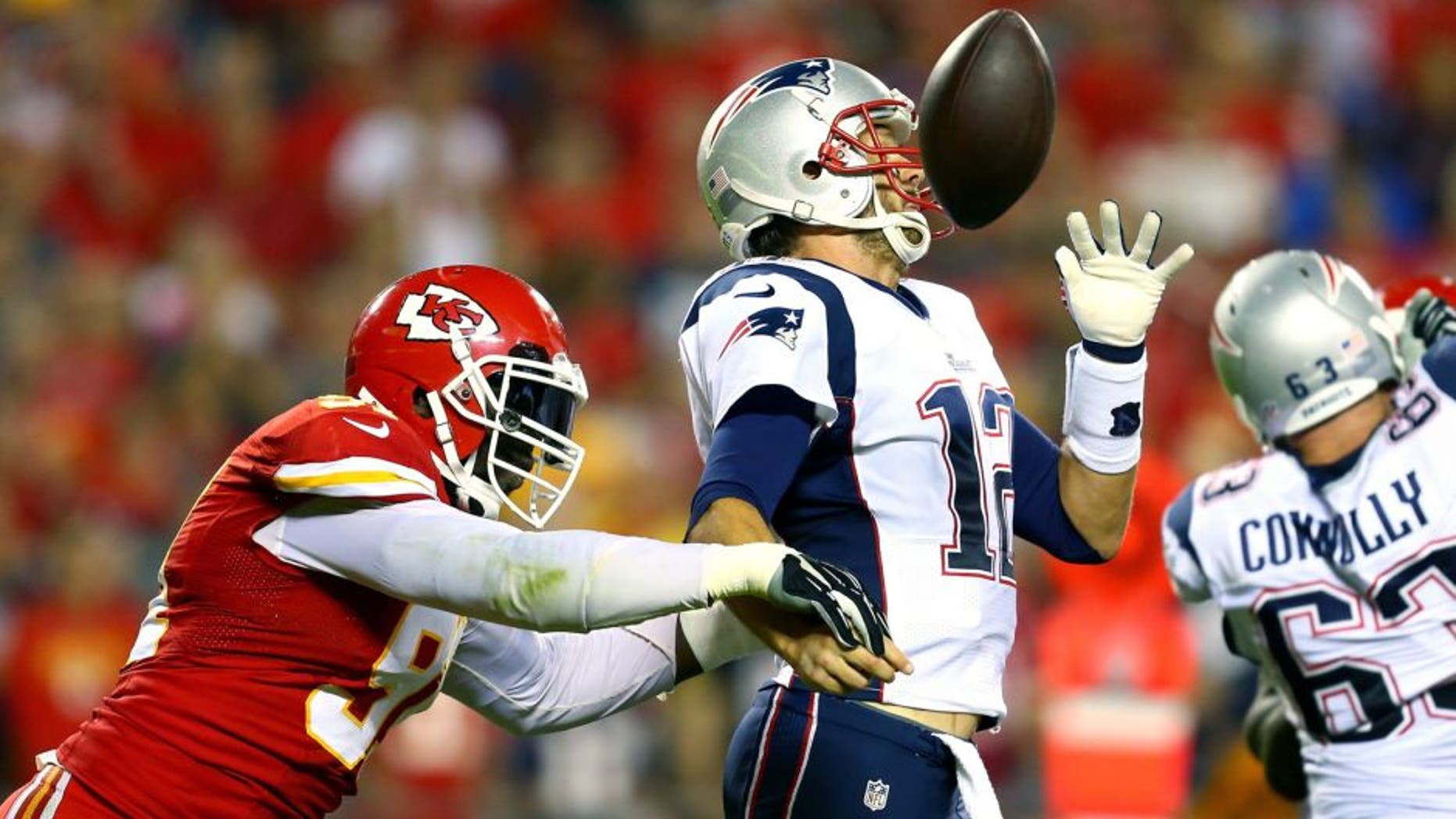 KANSAS CITY, MO - SEPTEMBER 29: Tamba Hali #91 of the Kansas City Chiefs knocks the ball loose from Tom Brady #12 of the New England Patriots for a fumble during the third quarter at Arrowhead Stadium on September 29, 2014 in Kansas City, Missouri. (Photo by Dilip Vishwanat/Getty Images)