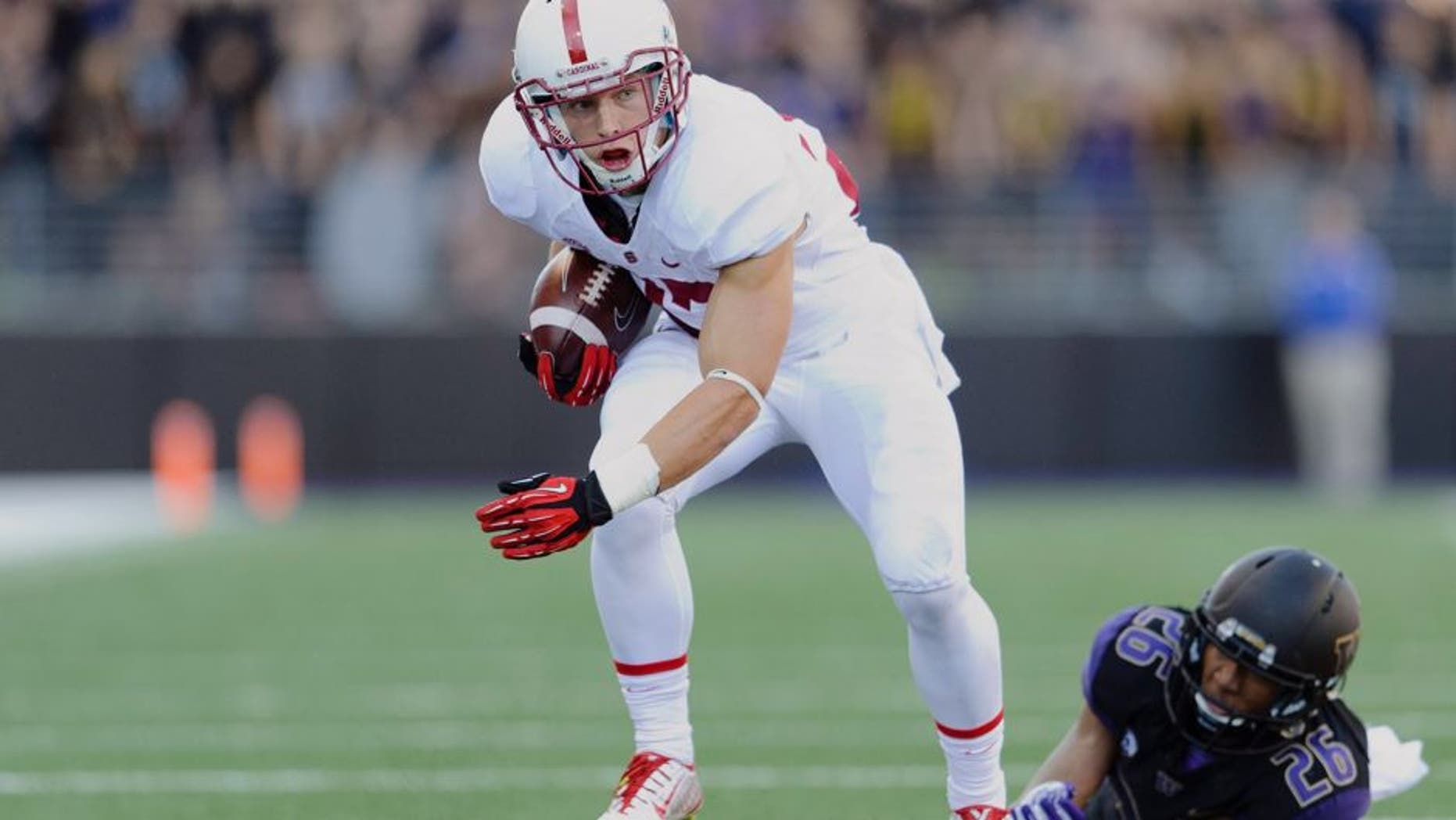 Sep 27, 2014; Seattle, WA, USA; Stanford Cardinal running back Christian McCaffrey (27) carries the ball against the Washington Huskies during the first half at Husky Stadium. Stanford defeated Washington 20-13. Mandatory Credit: Steven Bisig-USA TODAY Sports