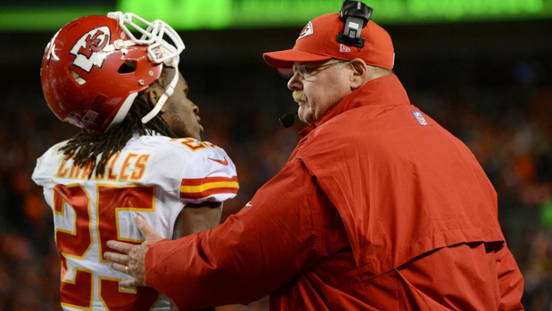 November 17, 2013; Denver, CO, USA; Kansas City Chiefs head coach Andy Reid (right) acknowledges running back Jamaal Charles (25) during the first quarter against the Denver Broncos at Sports Authority Field at Mile High. Mandatory Credit: Kyle Terada-USA TODAY Sports