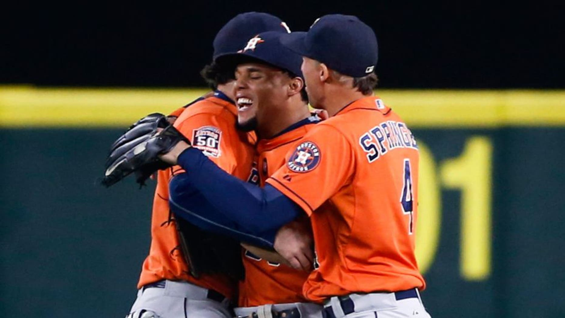 Sep 30, 2015; Seattle, WA, USA; Houston Astros center fielder Carlos Gomez (30) celebrates with left fielder Jake Marisnick (6) and right fielder George Springer (4) after making an outfield assist for a double play to end a 7-6 victory against the Seattle Mariners at Safeco Field. Mandatory Credit: Joe Nicholson-USA TODAY Sports