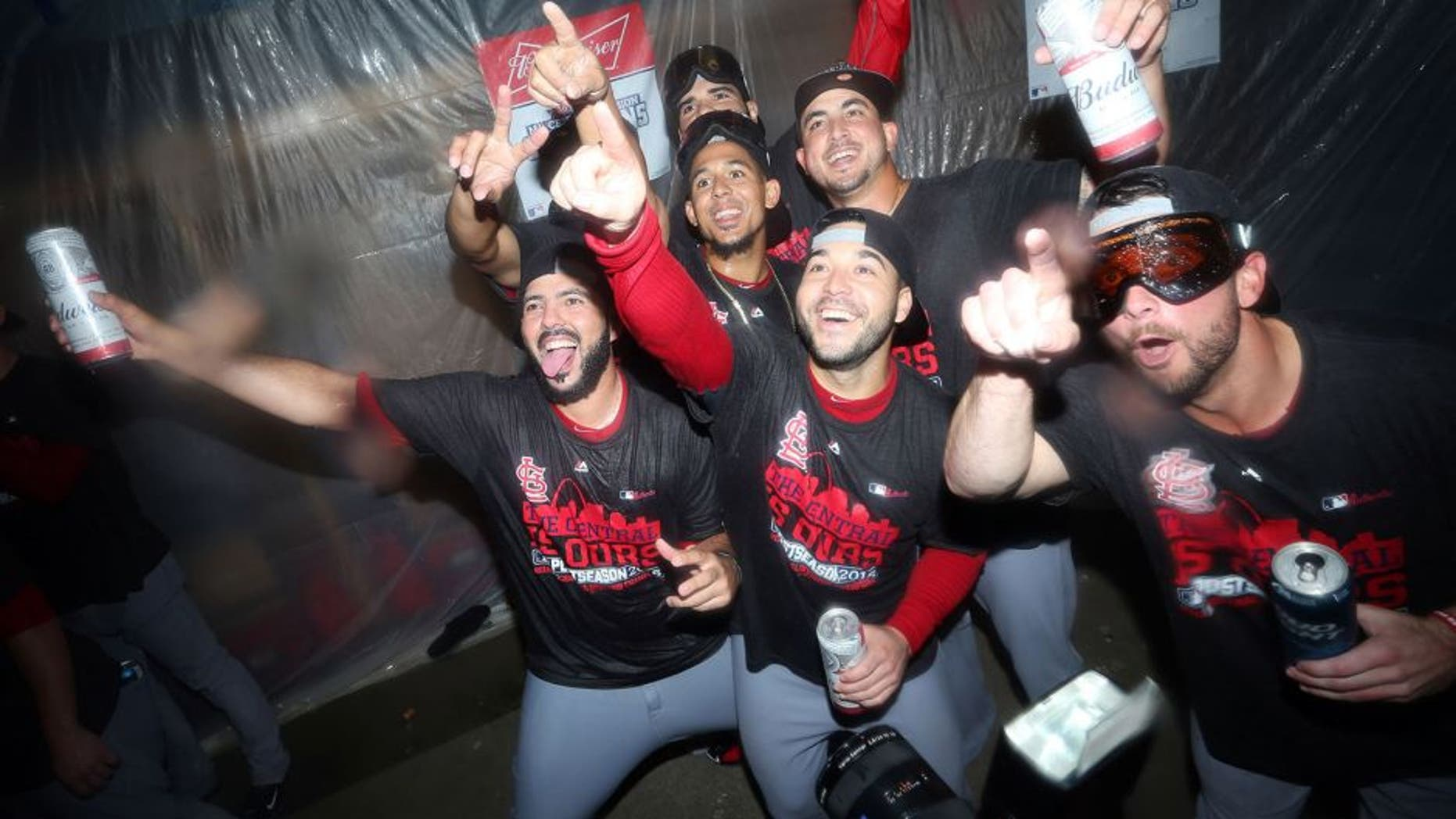 Sep 30, 2015; Pittsburgh, PA, USA; St. Louis Cardinals players pose for a photo after defeating the Pittsburgh Pirates to clinch the National League Central Division Championship at PNC Park. The Cardinals won 11-1. Mandatory Credit: Charles LeClaire-USA TODAY Sports