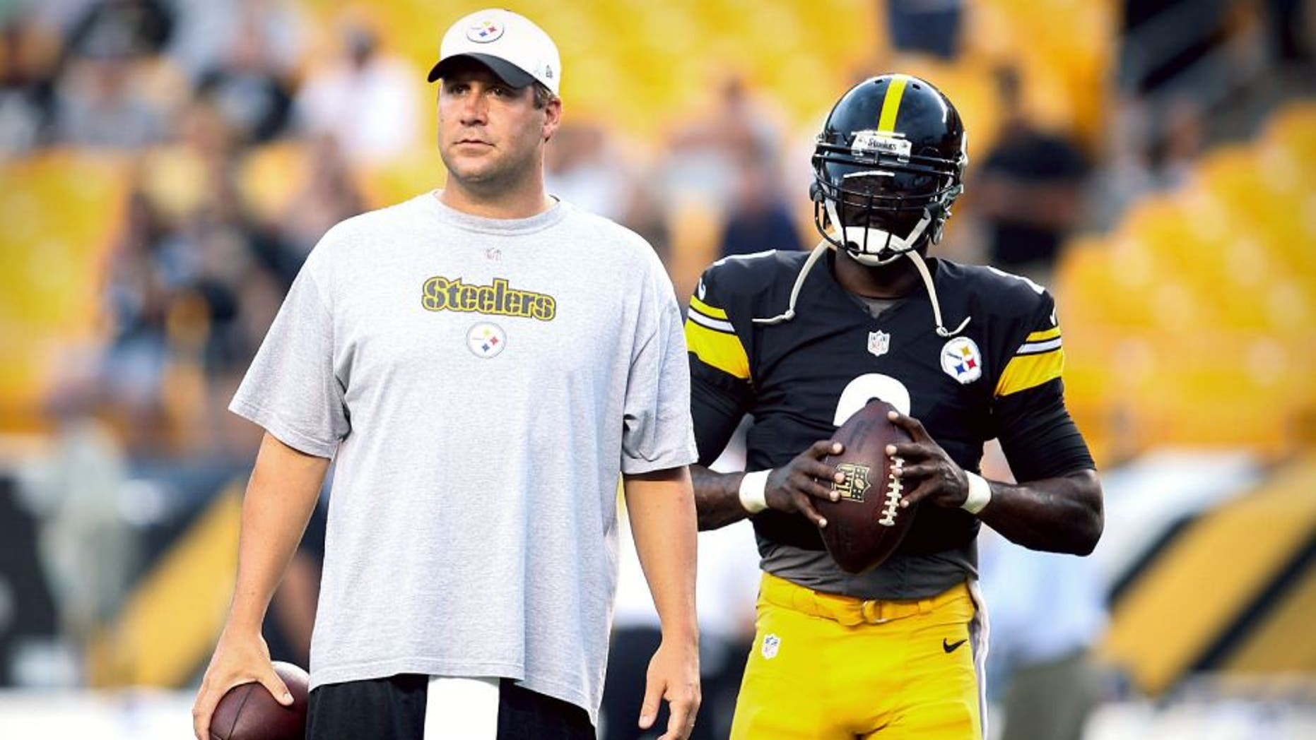 Sep 3, 2015; Pittsburgh, PA, USA; Pittsburgh Steelers quarterbacks Ben Roethlisberger (L) and Michael Vick (R) (2) on the field before playing the Carolina Panthers at Heinz Field. Mandatory Credit: Charles LeClaire-USA TODAY Sports