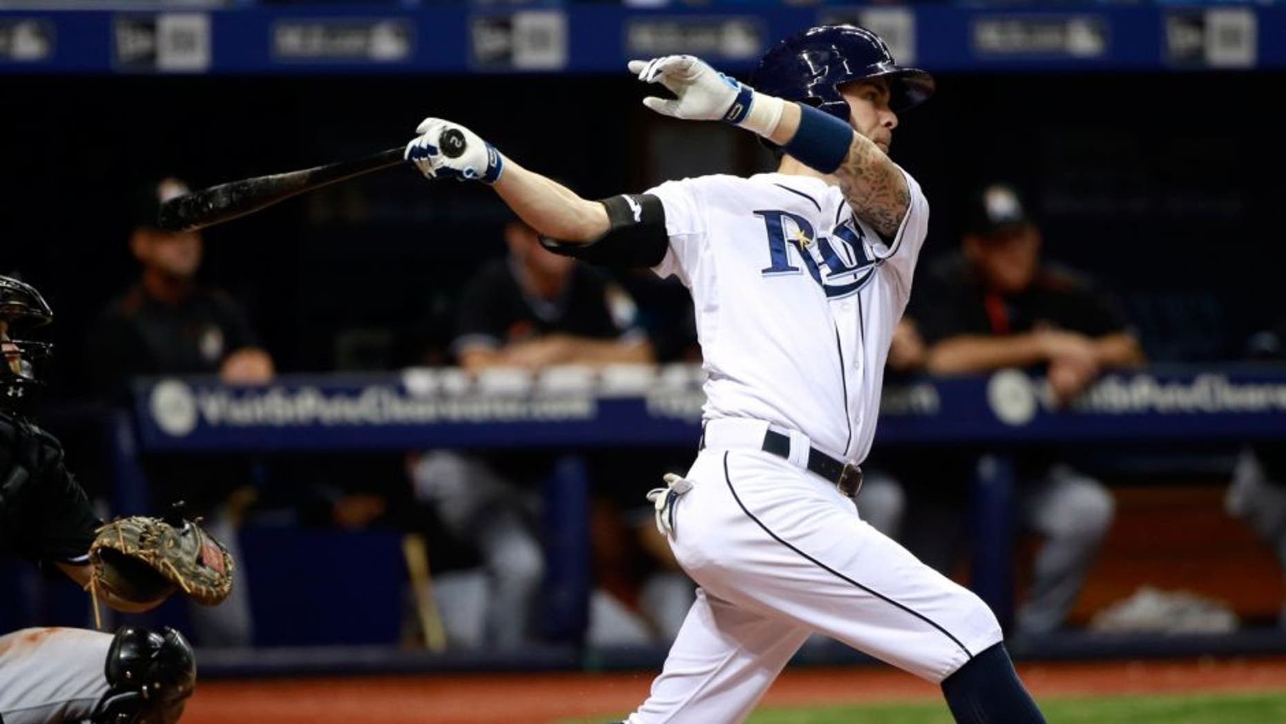 Sep 30, 2015; St. Petersburg, FL, USA; Tampa Bay Rays second baseman Nick Franklin (2) hits a home run during the fifth inning against the Miami Marlins at Tropicana Field. Mandatory Credit: Kim Klement-USA TODAY Sports