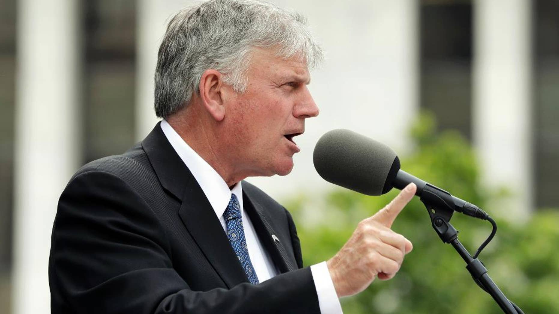 FILE - In this Thursday, Aug. 25, 2016 file photo, the Rev. Franklin Graham speaks during an election prayer rally outside the state Capitol in Albany, N.Y. Graham is scheduled to hold a mass prayer rally as part of a 50-state tour to urge evangelicals to vote, Tuesday, Aug. 30, 2016, on Boston Common. (AP Photo/Mike Groll, File)