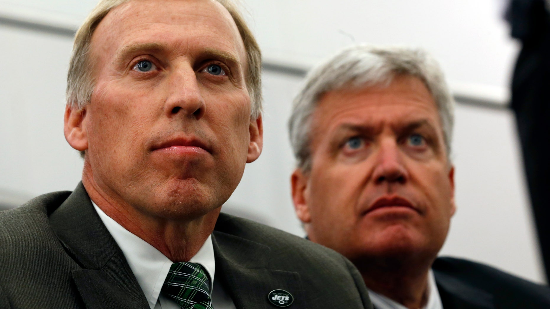 FILE - In this Jan. 24, 2013 file photo, John Idzik, left, sits next to New York Jets head coach Rex Ryan while waiting to be introduced as the Jets new general manager during an NFL football news conference in Florham Park, N.J. Idzik's first headline-making move as the Jets' general manager was trading away his best player. Idzik will now try to find a few guys who can help get the franchise _ which was a win away from the Super Bowl in the 2009 and '10 seasons _ back on track. (AP Photo/Julio Cortez, File)