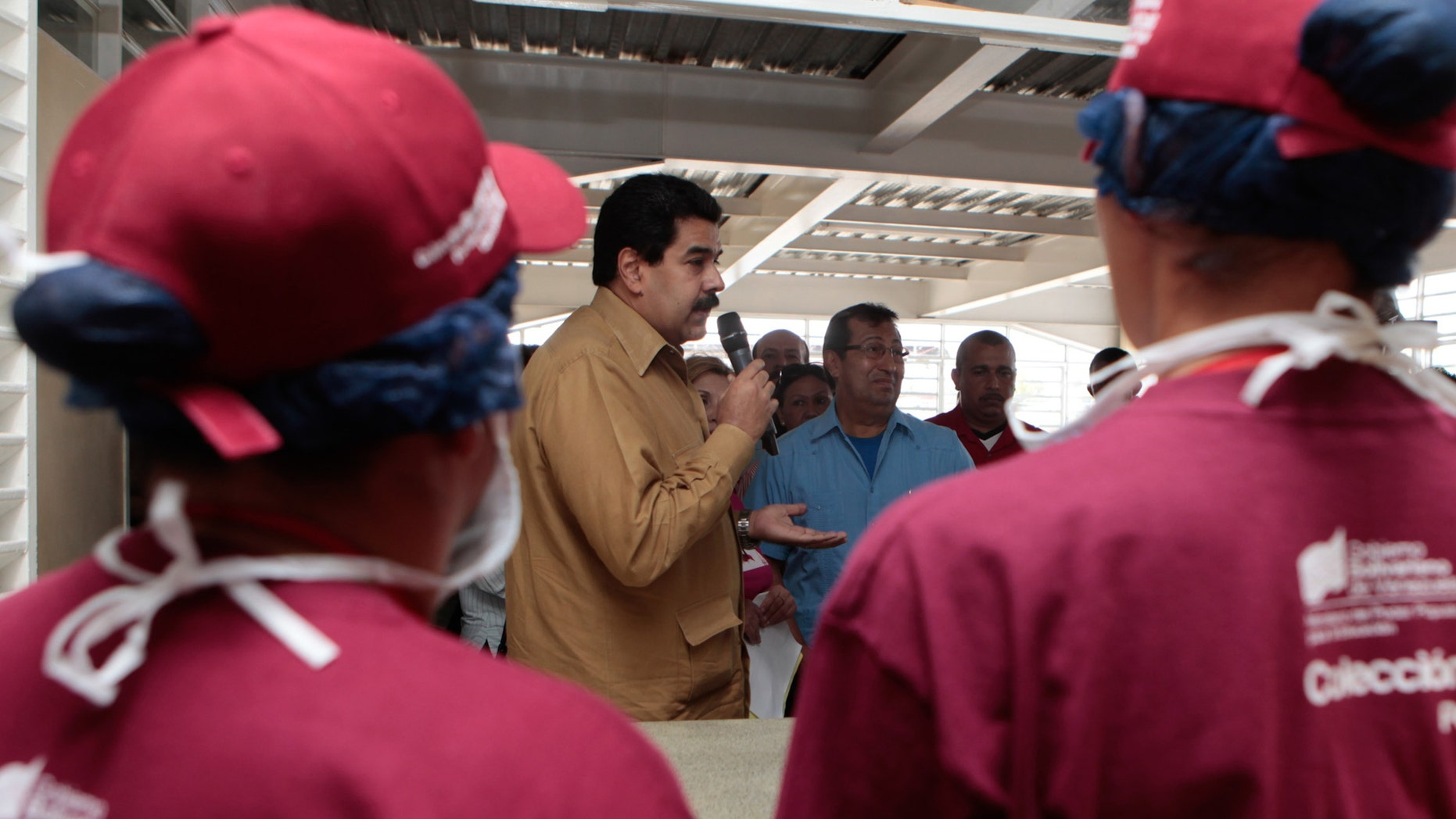 Jan. 18, 2013: In this photo released by Miraflores Press Office, Venezuela's Vice President Nicolas Maduro, center,  speaks to students during the inauguration of a school in Barinas, Venezuela.