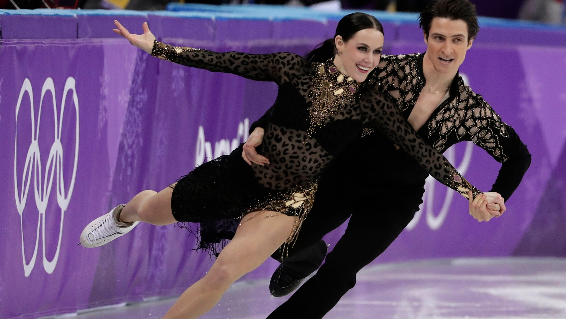 Tessa Virtue and Scott Moir of Canada perform during the ice dance, short dance figure skating in the Gangneung Ice Arena at the 2018 Winter Olympics in Gangneung, South Korea, Monday, Feb. 19, 2018. (AP Photo/Julie Jacobson)