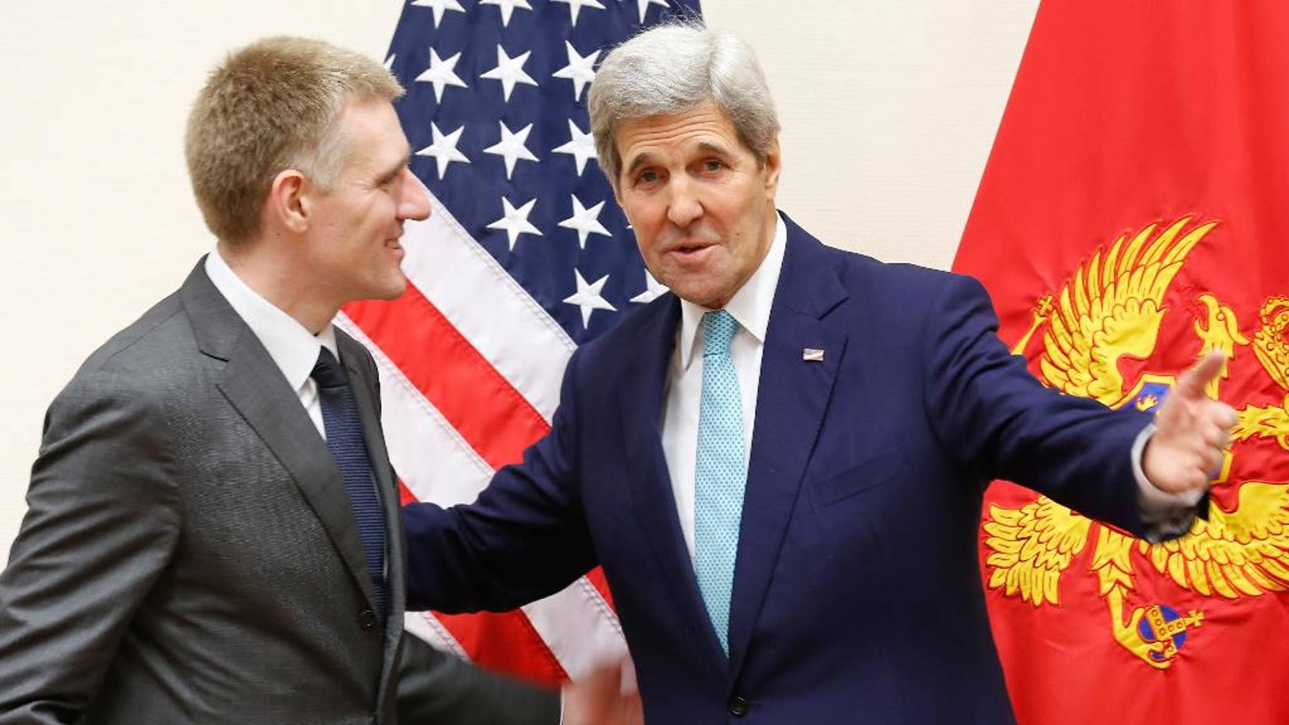 U.S. Secretary of State John Kerry, right, meets Montenegro's Foreign Minister Igor Luksic at the NATO ministerial meetings at NATO Headquarters in Brussels, Wednesday Dec. 2, 2015. Montenegro was welcomed during the meetings as a new NATO member. (Jonathan Ernst / Pool via AP)