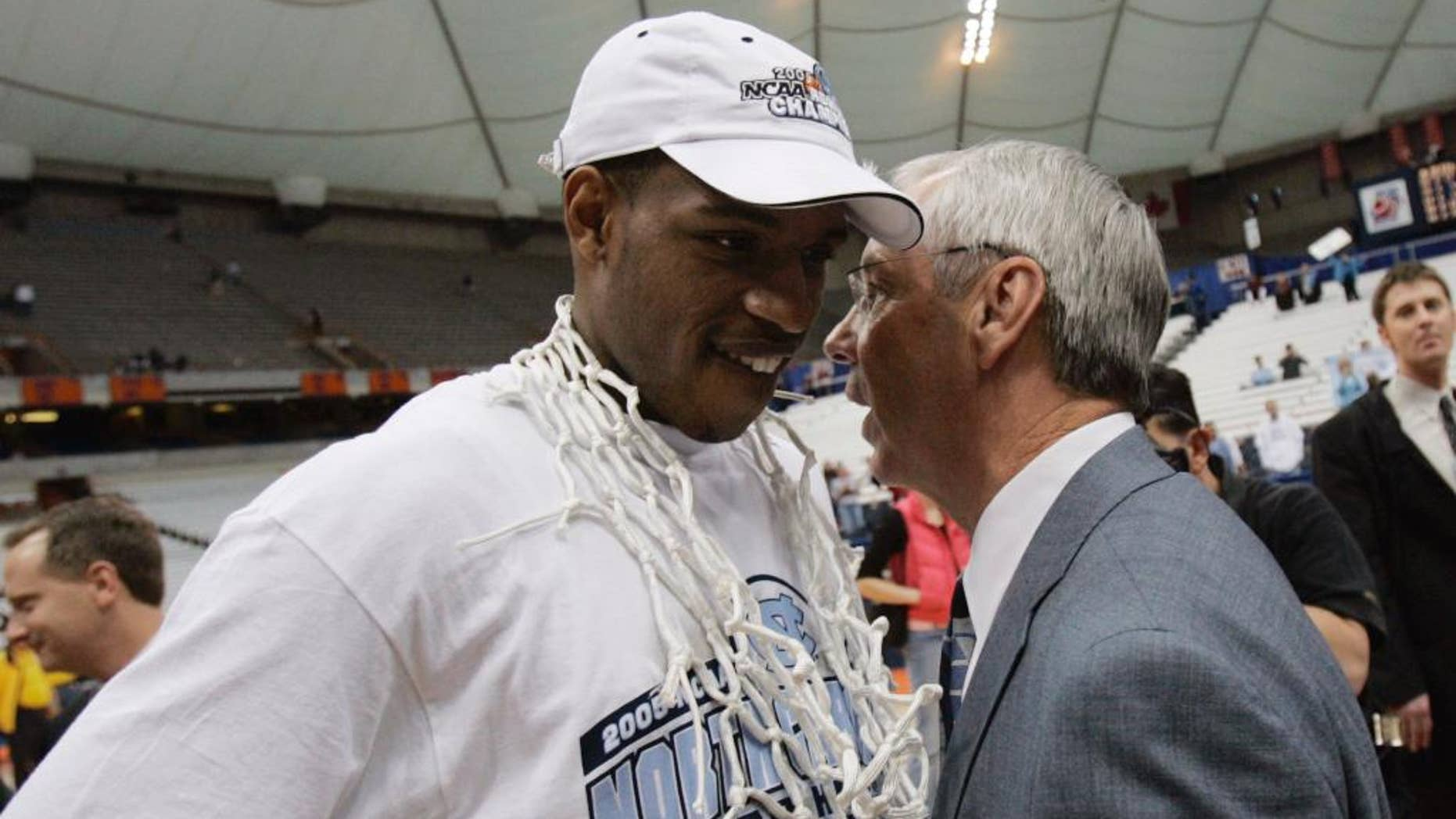 """File- This March 27, 2005, file photo shows North Carolina coach Roy Williams chatting with Rashad McCants after defeating Wisconsin 88-82 to win the NCAA East Regional in Syracuse, N.Y.  Williams denied allegations of academic wrongdoing Friday, June 6, 2014, by former player McCants connected to the school's long-running academic scandal. In an interview with ESPN's """"Outside the Lines"""" to air Friday, McCants, the second-leading scorer on Williams' first NCAA championship team in 2005, said tutors wrote papers for him and that Williams knew about no-show classes popular with athletes.  (AP Photo/David Duprey, File)"""