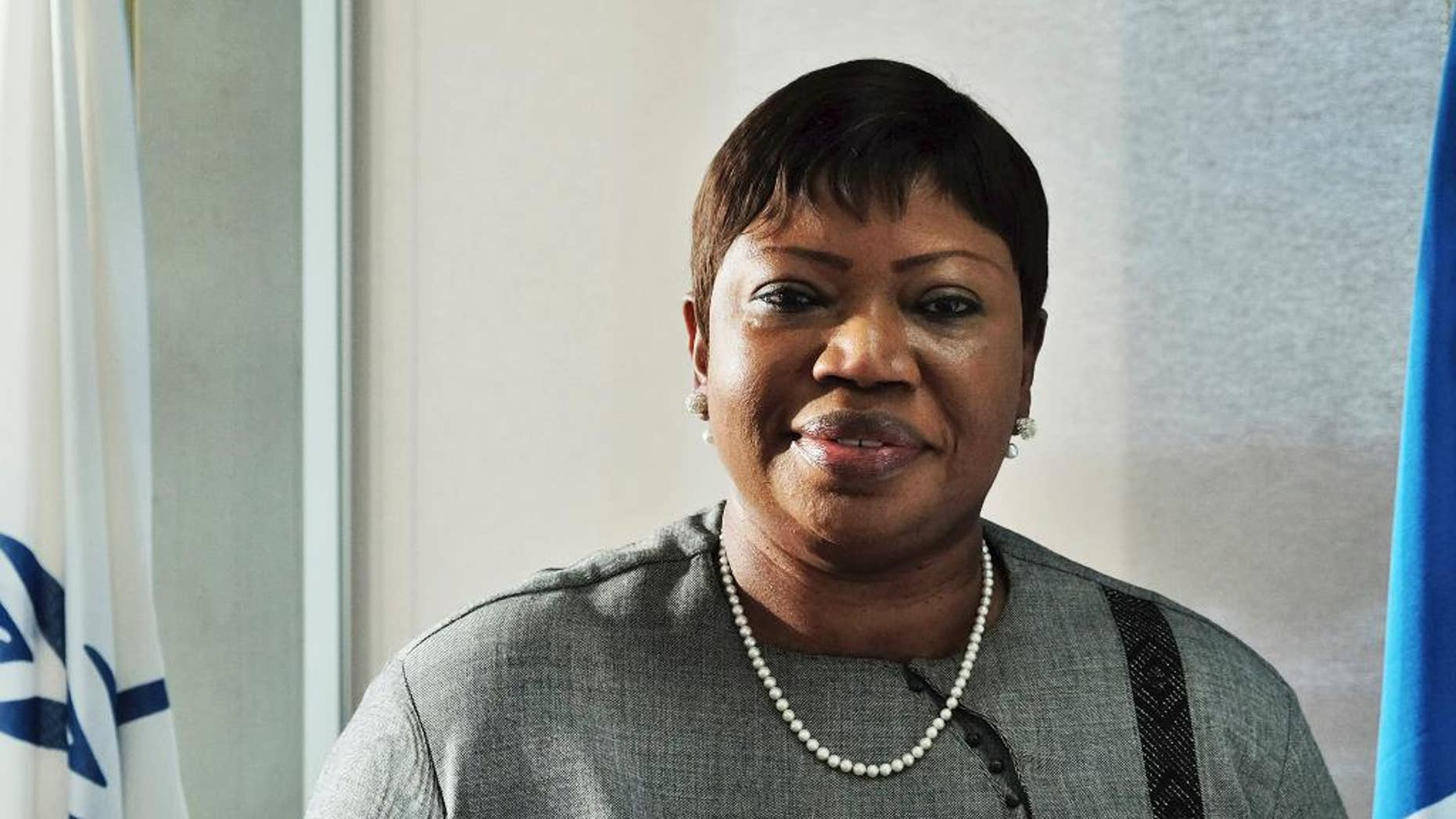"The International Criminal Court's prosecutor Fatou Bensouda poses for a picture during an interview in The Hague, Netherlands, Tuesday, Nov. 22, 2016. Bensouda says it is a ""regression"" for African nations, including her own home country of Gambia, to quit the court and says the continent should work together with her office to end impunity for atrocities. (AP Photo/Mike Corder)"