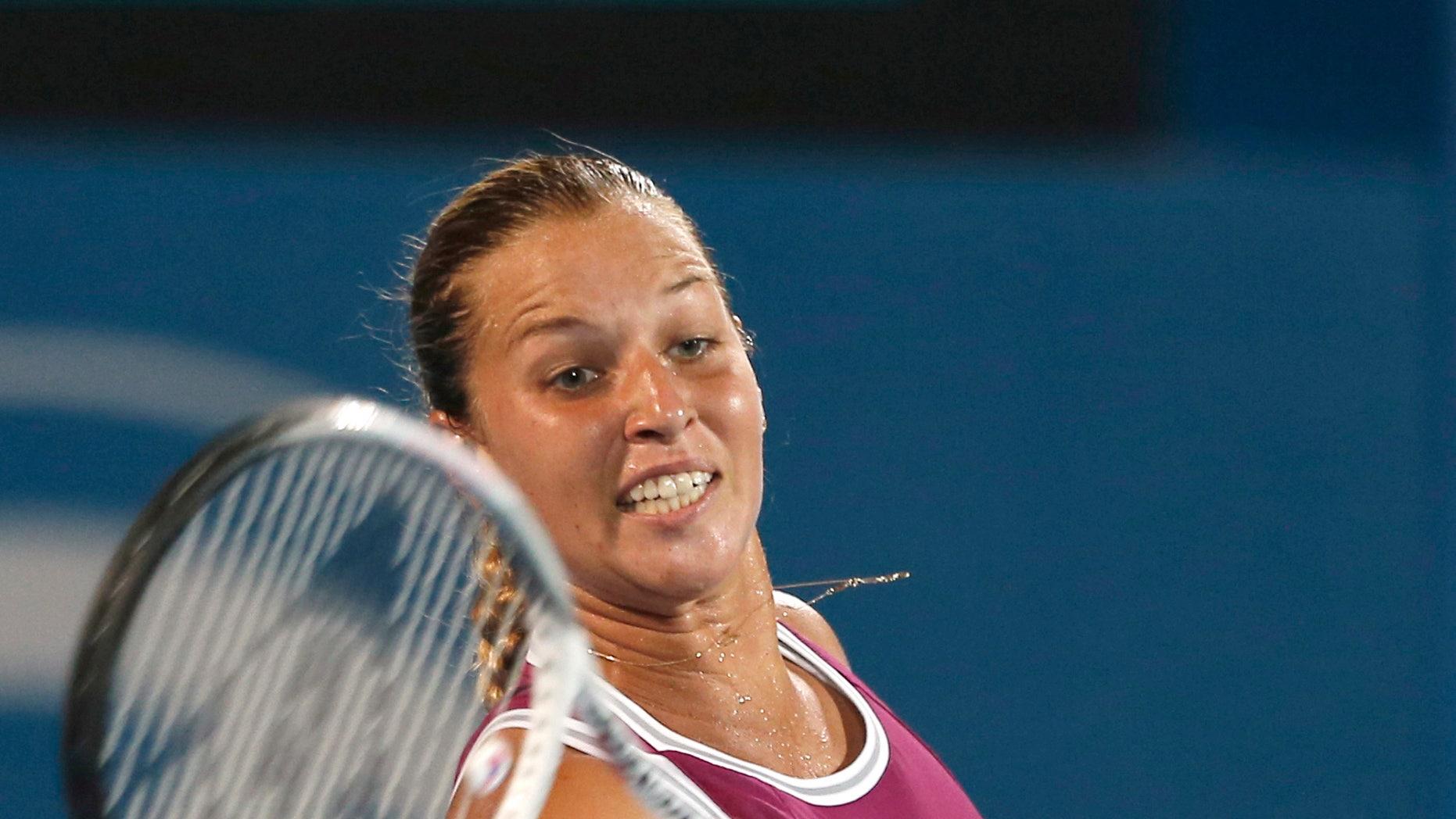 Slovakia's Dominika Cibulkova returns a shot to Poland's Agnieszka Radwanska during the women's final of the Sydney International tennis tournament in Sydney, Australia, Friday, Jan. 11, 2013. Radwanska won the match 6-0, 6-0. (AP Photo/Rob Griffith)