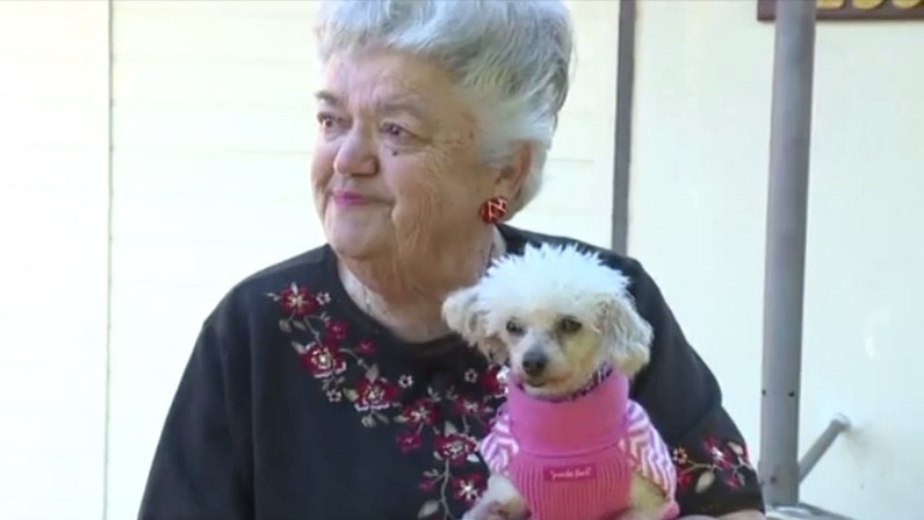 Sally Butters and her dog, Gigi.