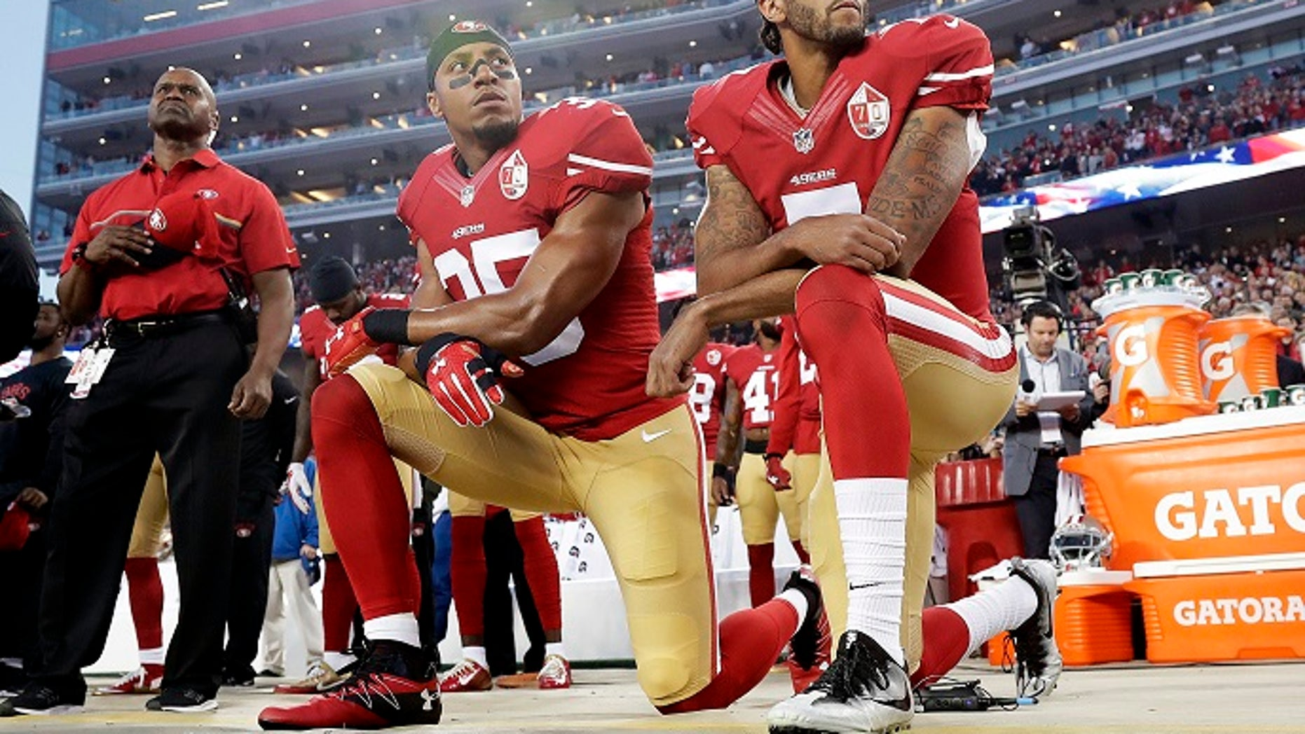 In this Monday, Sept. 12, 2016, file photo, San Francisco 49ers safety Eric Reid (35) and quarterback Colin Kaepernick (7) kneel during the national anthem before a game against the Los Angeles Rams in Santa Clara, Calif.