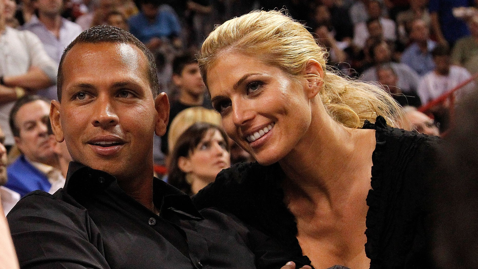 MIAMI, FL - JANUARY 17: Baseball player Alex Rodriguez (L) of the New York Yankees and Torrie Wilson watch a game between the Miami Heat and the San Antonio Spurs at American Airlines Arena on January 17, 2012 in Miami, Florida. NOTE TO USER: User expressly acknowledges and agrees that, by downloading and/or using this Photograph, User is consenting to the terms and conditions of the Getty Images License Agreement.  (Photo by Mike Ehrmann/Getty Images)
