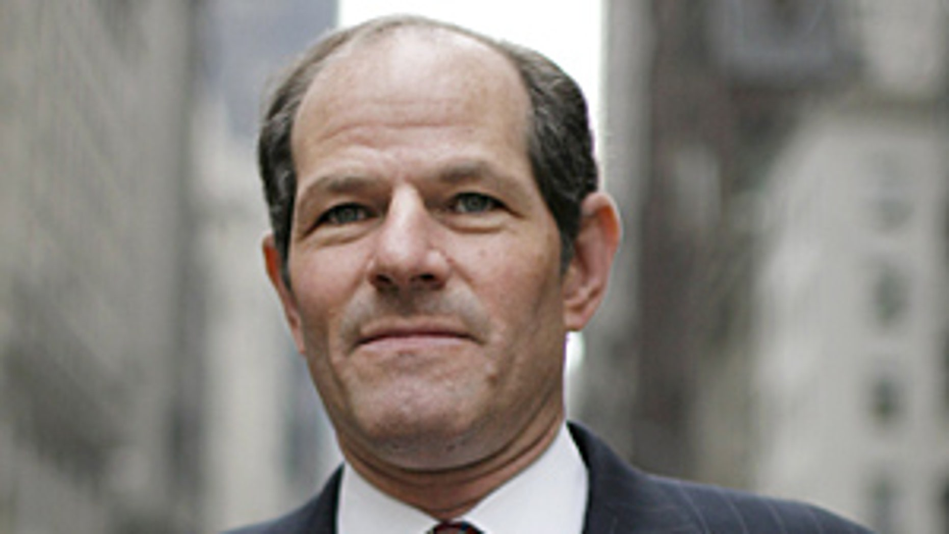 "NEW YORK - APRIL 7: ""EXCLUSIVE"" Former New York Governor and Attorney General Eliot Spitzer works at the family firm started by his father Bernard Spitzer on 5th Avenue and goes about his business on the streets of New York on April 10, 2009 in New York, NY.  On March 10, 2008, The New York Times reported that Spitzer was a client of a prostitution ring under investigation by the federal government. Two days later, he announced his resignation as governor of New York, effective March 17, citing ""private failings"".  (Photo by Charles Ommanney/Getty Images)"