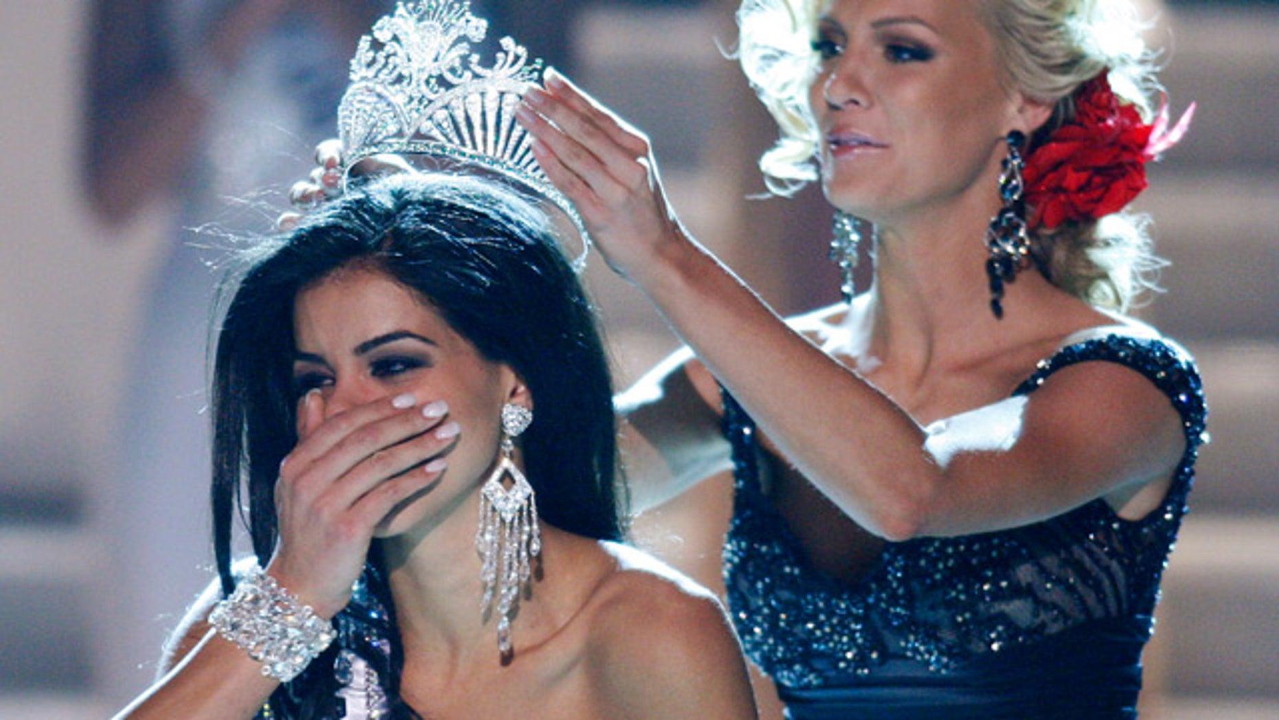 May 16: Miss Michigan Rima Fakih is crowned Miss USA 2010 by Kristen Dalton, Miss USA 2009.