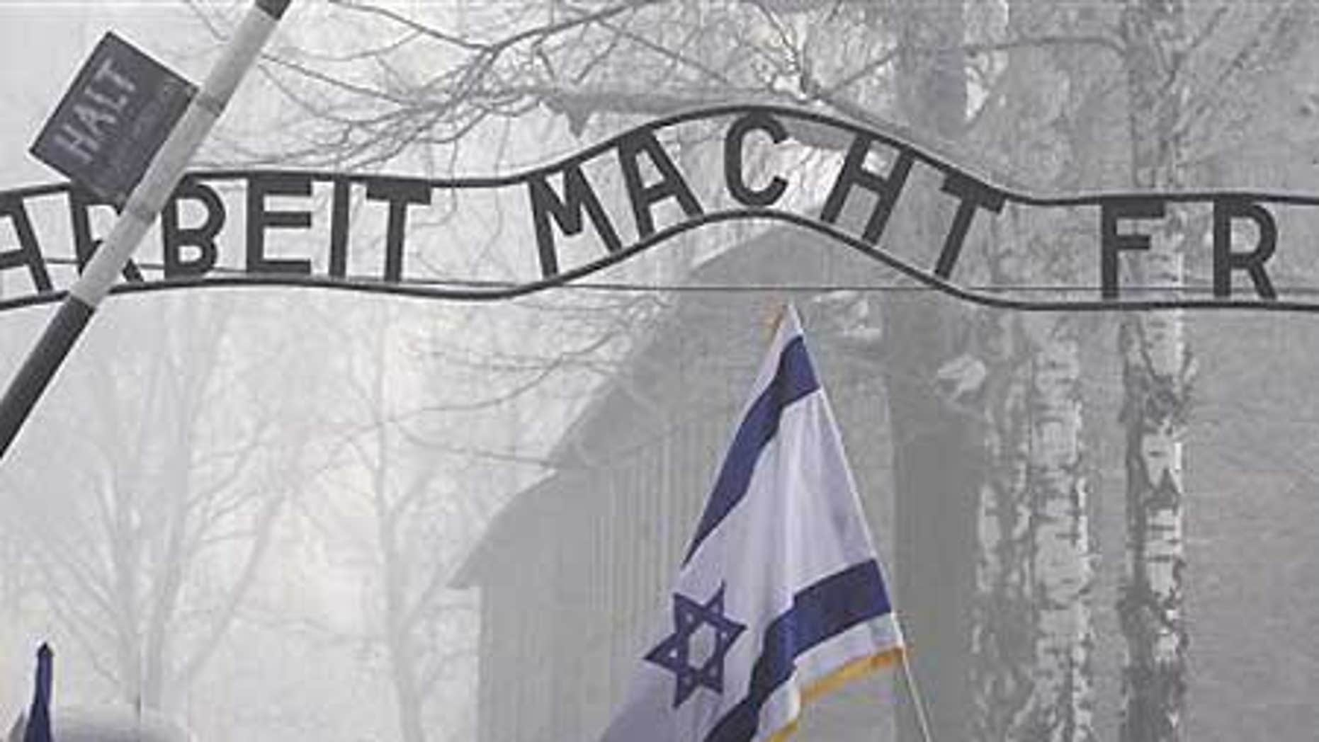Jan. 27: Visitors under the infamous Arbeit Macht Frei 'Work Sets You Free' sign over the main gate of Auschwitz.