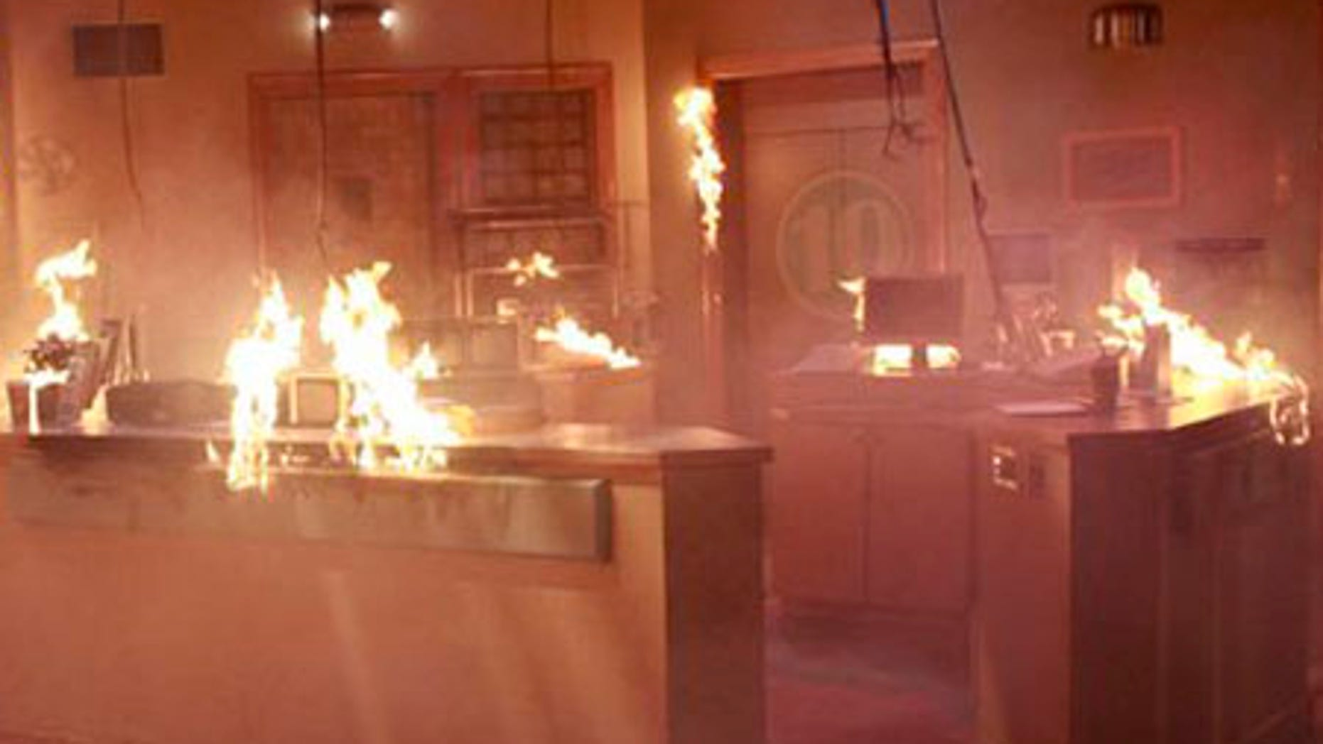 """In this image released by ABC, the nurses hub set from the daytime series """"General Hospital,"""" is shown ablaze. After 45 years, the ABC daytime soap's long-standing hospital set is flatlining as part of an explosive storyline. Following a fiery crisis, the show's crew has ignited the clinical den of drama, and producers plan to construct a totally new interior. (AP Photo/ABC, Ron Tom) ** NO SALES **"""