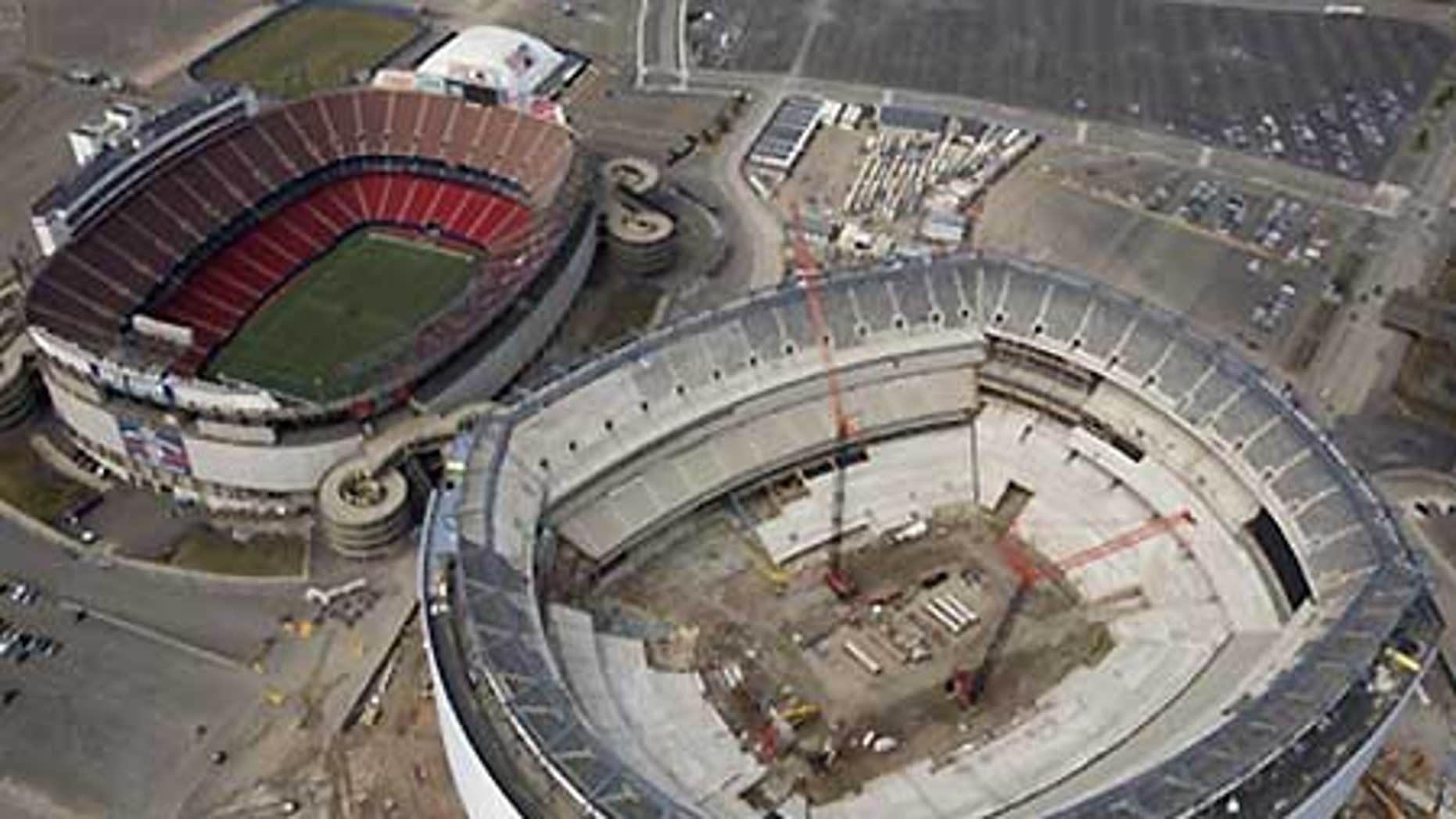 March 22: The under-construction Giants Stadium, right, and the older and still in use Giants Stadium, left.