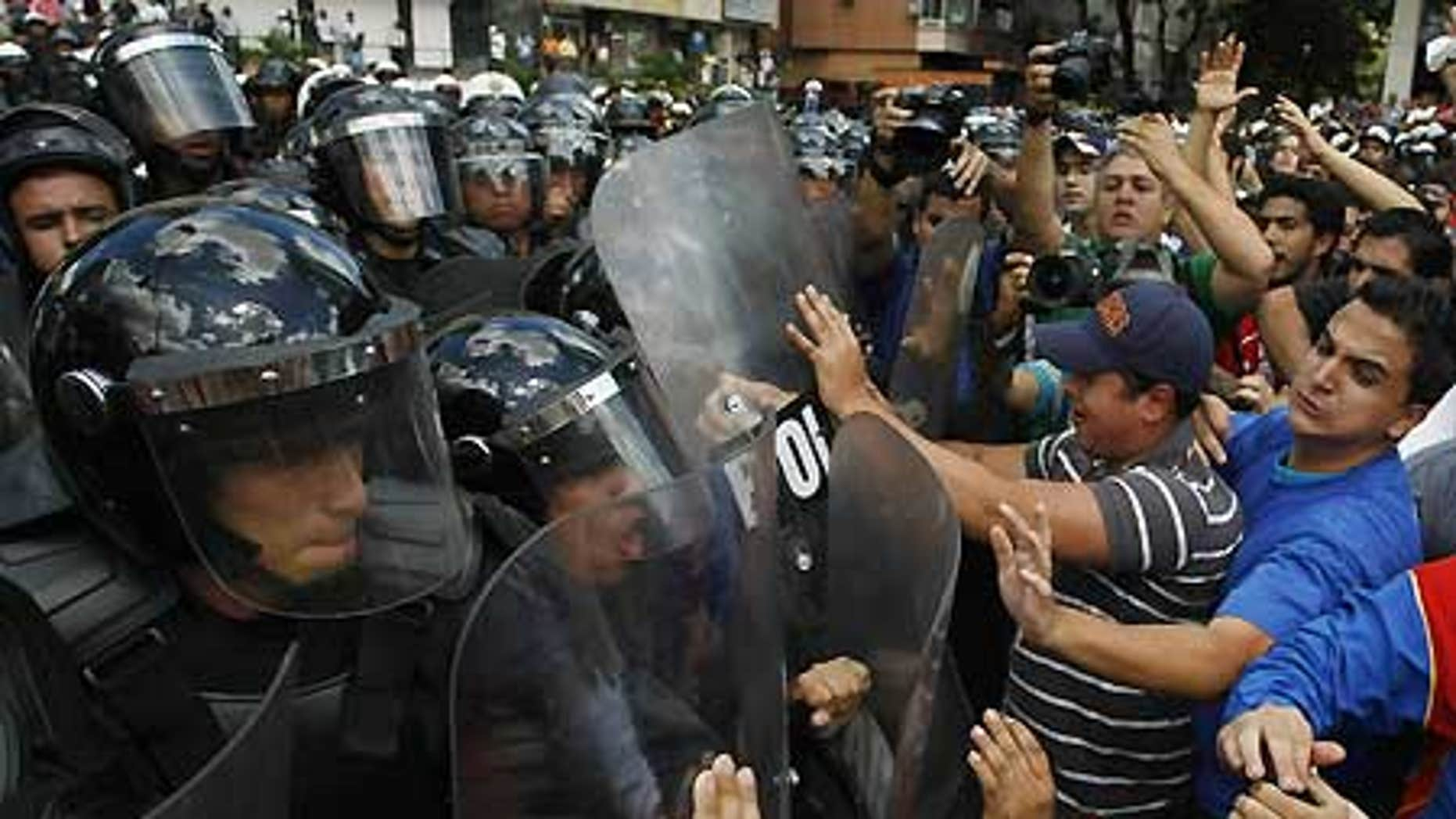 Feb. 4: University students clash with police during a protest against Venezuela's President Hugo Chavez in Caracas.