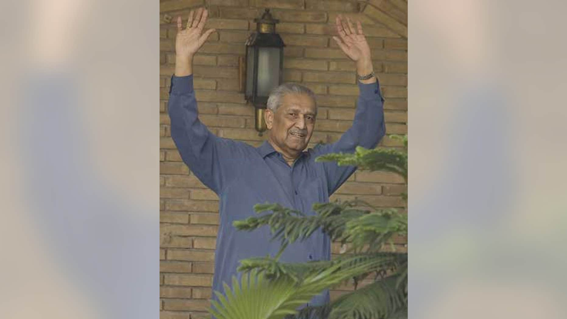 Feb. 6: Disgraced Pakistani nuclear scientist Abdul Qadeer Khan waves to media at his home in Islamabad, Pakistan.
