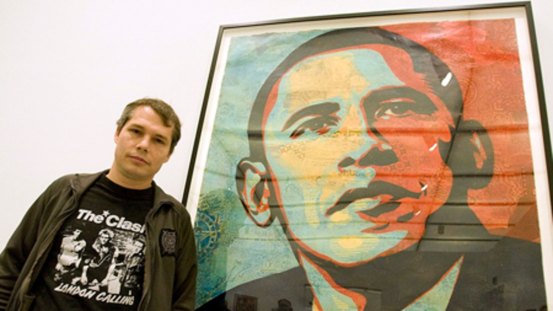 """Feb. 3, 2009: Artist Shepard Fairey poses beside his """"Obama HOPE"""" image, part of an exhibit of his work at the Institute of Contemporary Art."""