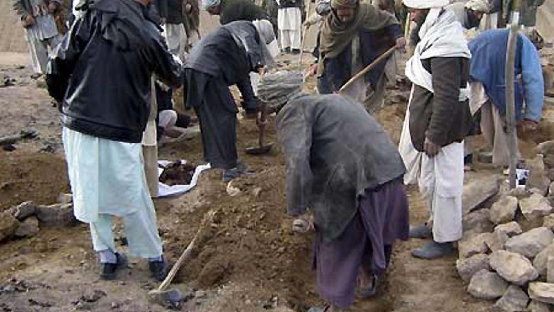 Feb. 17: Afghans dig graves for the victims who villagers said were killed in an airstrike, in Gozara district of Herat province, west of Kabul.