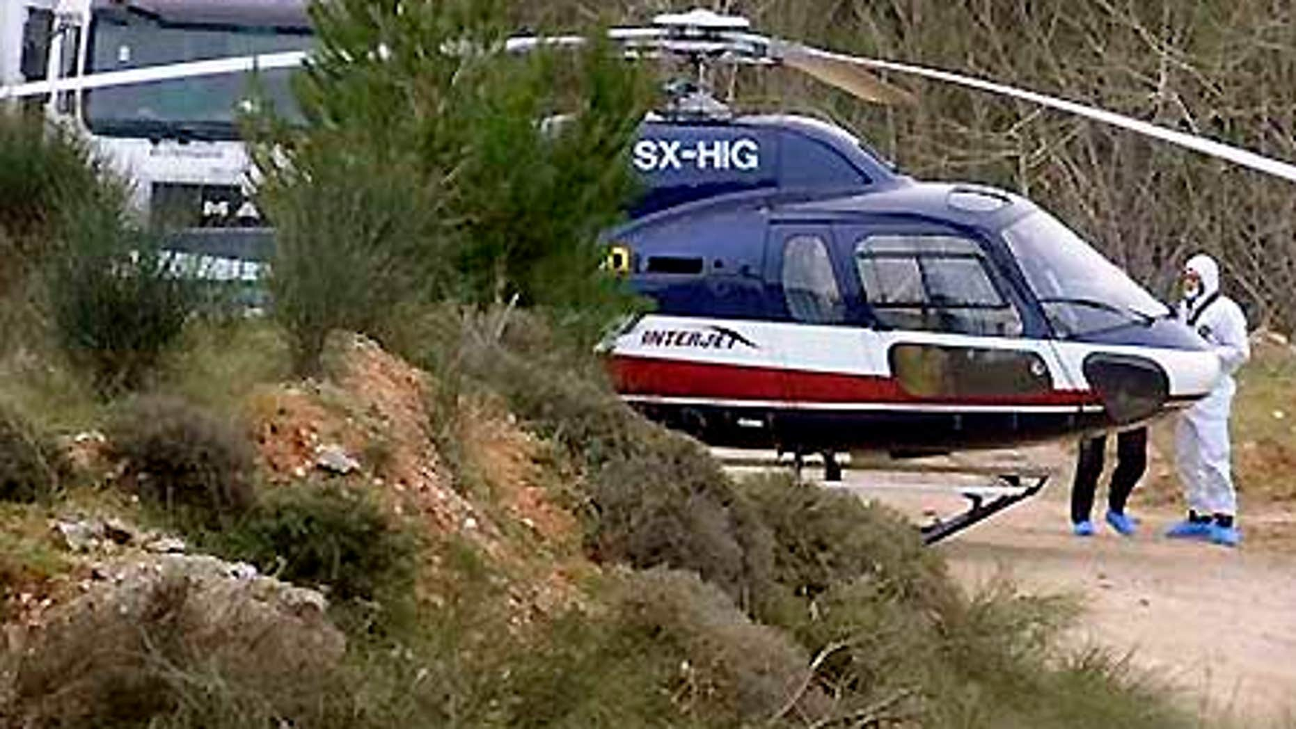 Feb. 22: Forensic experts investigate a helicopter used in the escape of convicts Vassilis Paleokostas and Alket Rizaj from a high-security prison.