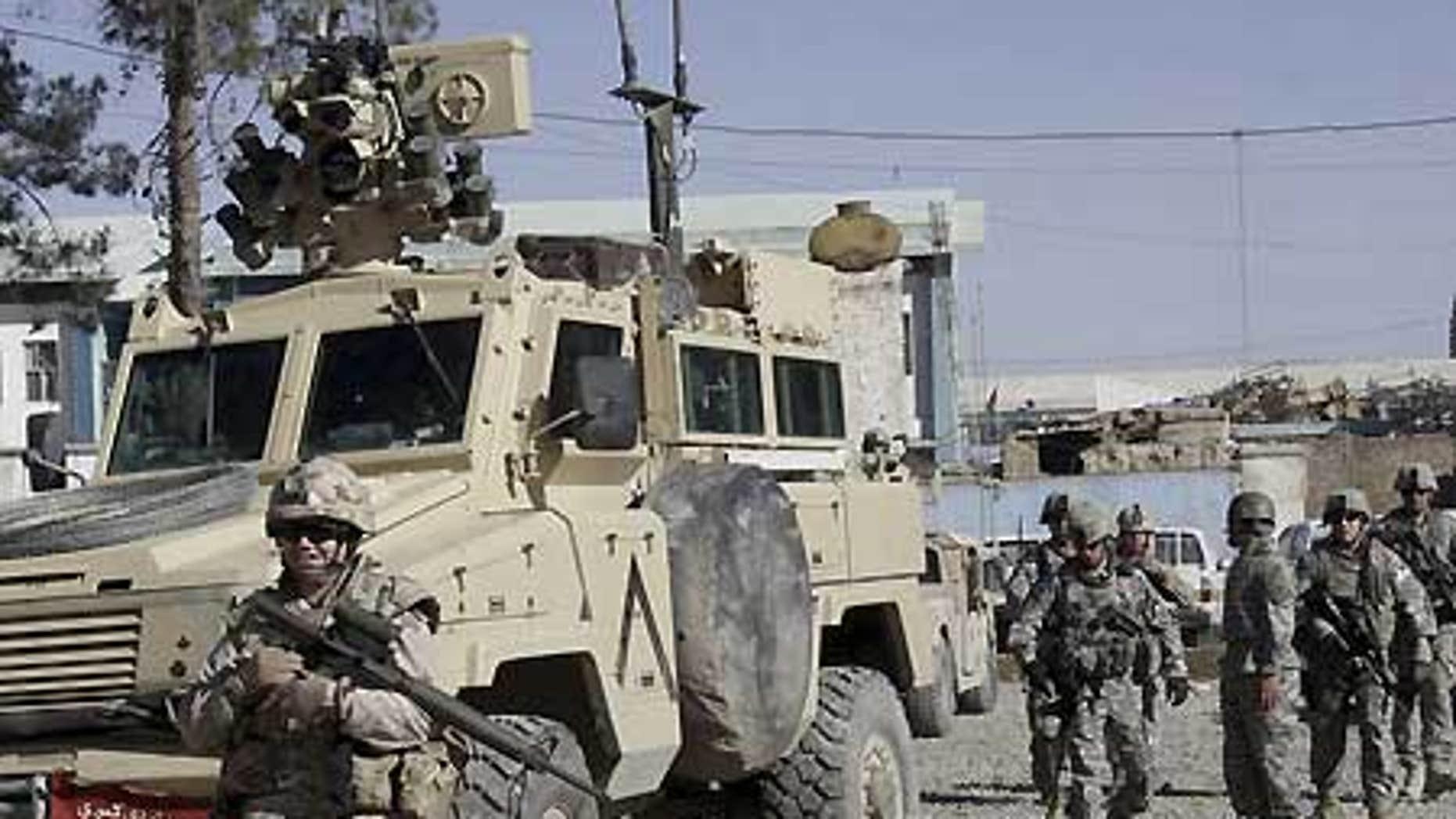 Feb. 15: U.S., Canadian soldiers investigate suspected Taliban militants in Kandahar, Afghanistan.