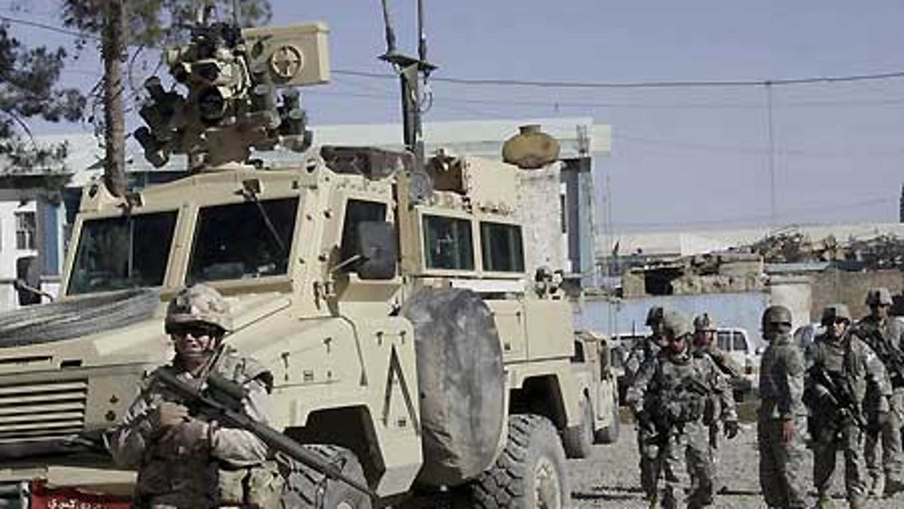 Feb. 15: U.S., Canadian soldiers investigate suspected Taliban militants in Kandahar, Afghanistan.