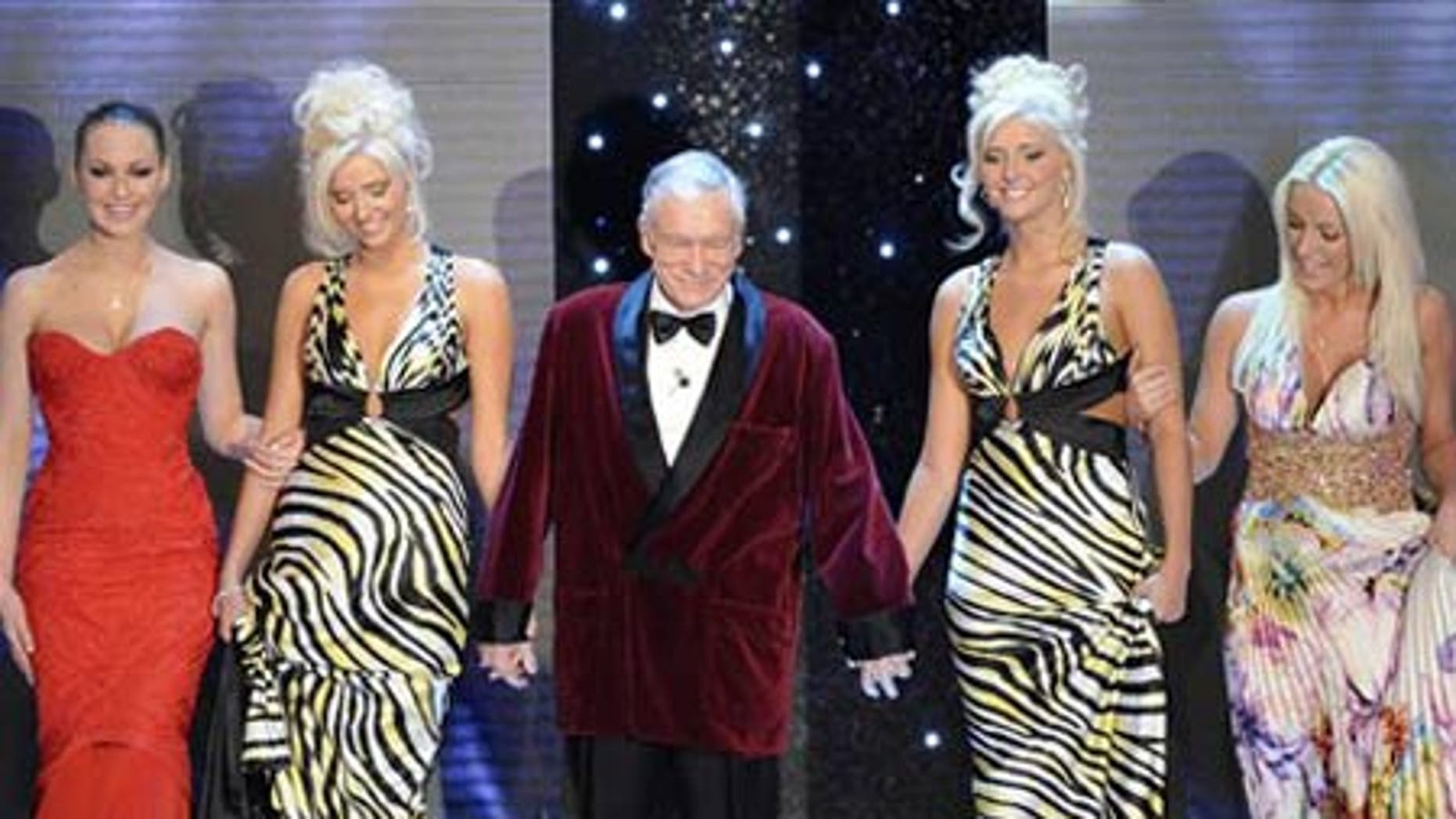 "Feb. 20: Hugh Hefner arrives with his girlfriends at the ""Festival di Sanremo"" Italian song contest, in San Remo, Italy."