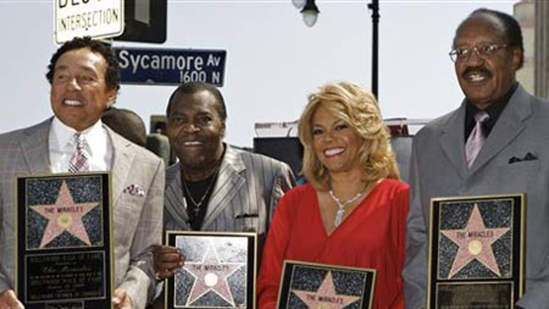 """March 20: Members of the Motown group,""""The Miracles"""" are honored with a star on the Hollywood Walk of Fame in Los Angeles."""